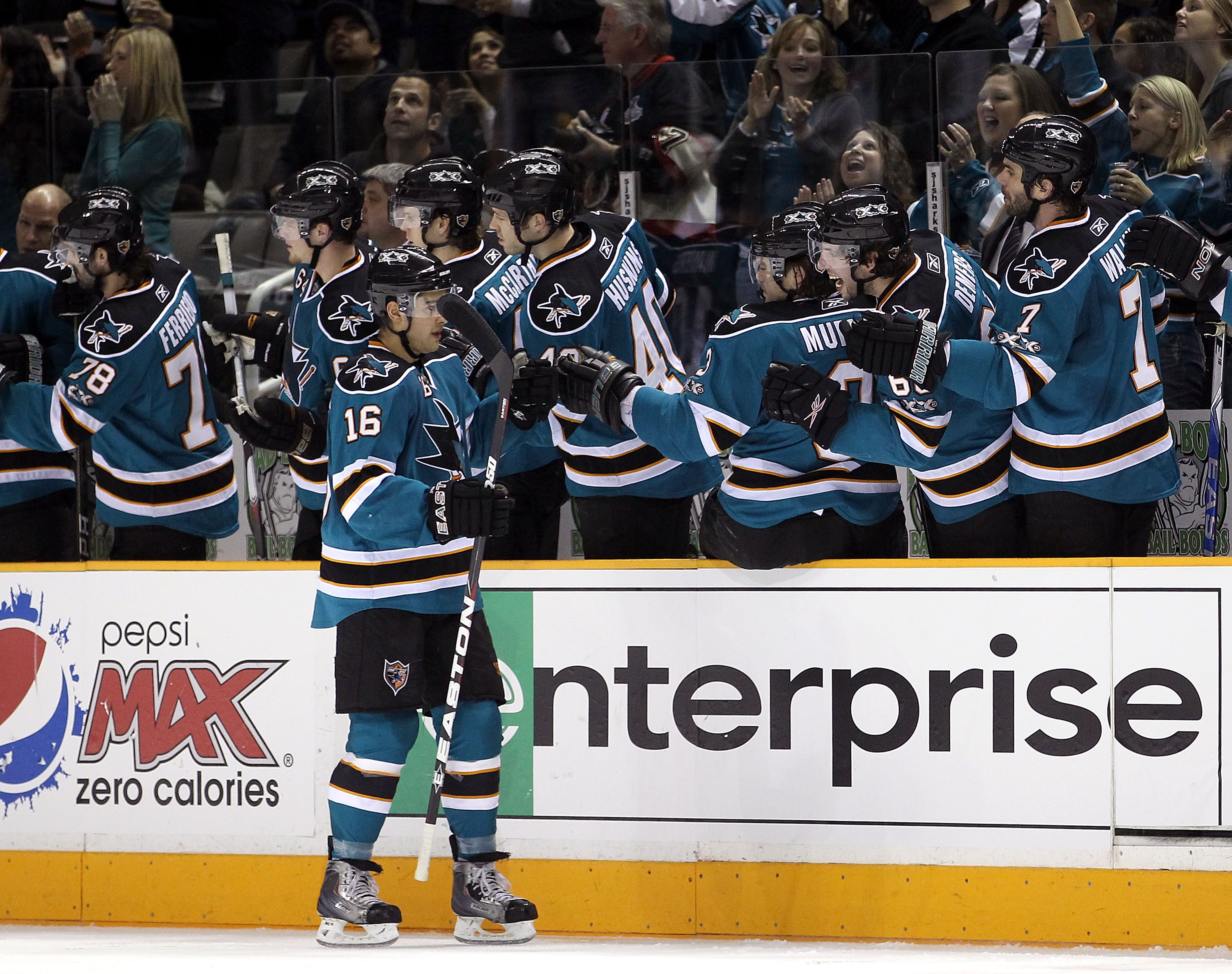 SAN JOSE, CA - JANUARY 22:  Devin Setoguchi #16 of the San Jose Sharks is congratulated by teammates after he scored a goal against the Minnesota Wild at HP Pavilion on January 22, 2011 in San Jose, California.  (Photo by Ezra Shaw/Getty Images)