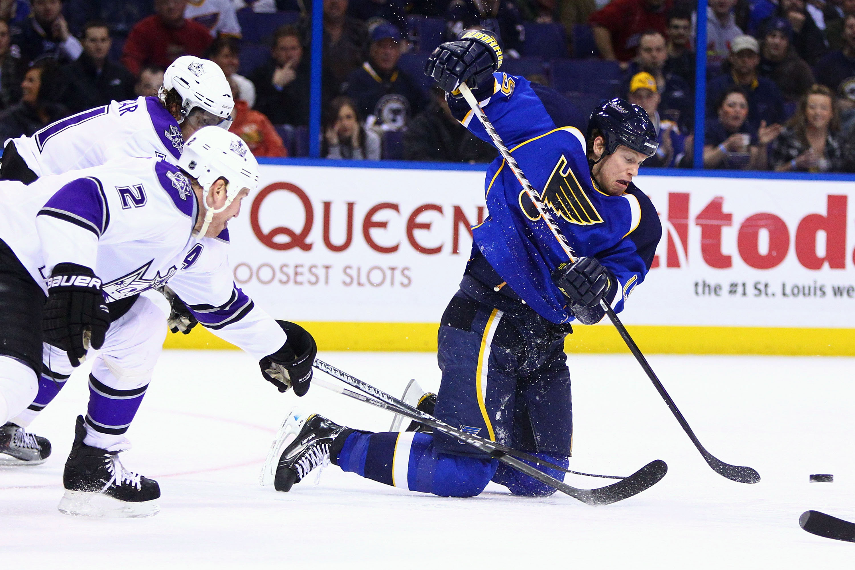 ST. LOUIS, MO - JANUARY 18: Brad Winchester #15 of the St. Louis Blues passes the puck against the Los Angeles Kings at the Scottrade Center on January 18, 2011 in St. Louis, Missouri.  (Photo by Dilip Vishwanat/Getty Images)