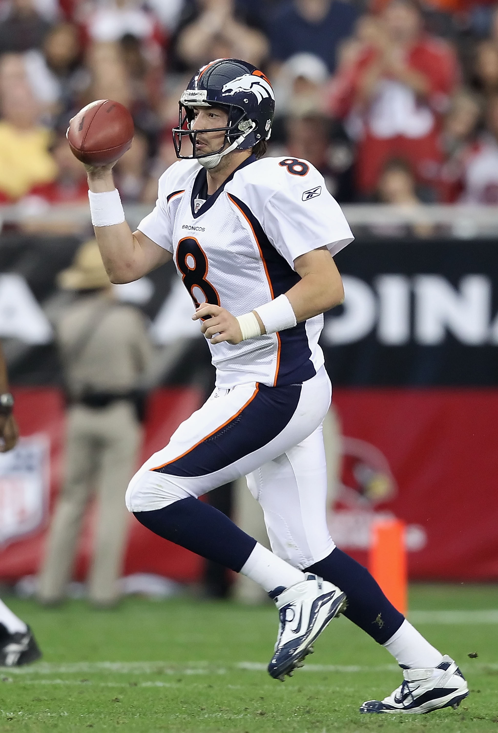 GLENDALE, AZ - DECEMBER 12:  Quarterback Kyle Orton #8 of the Denver Broncos drops back to pass during the NFL game against the Arizona Cardinals at the University of Phoenix Stadium on December 12, 2010 in Glendale, Arizona.  The Cardinals defeated the B
