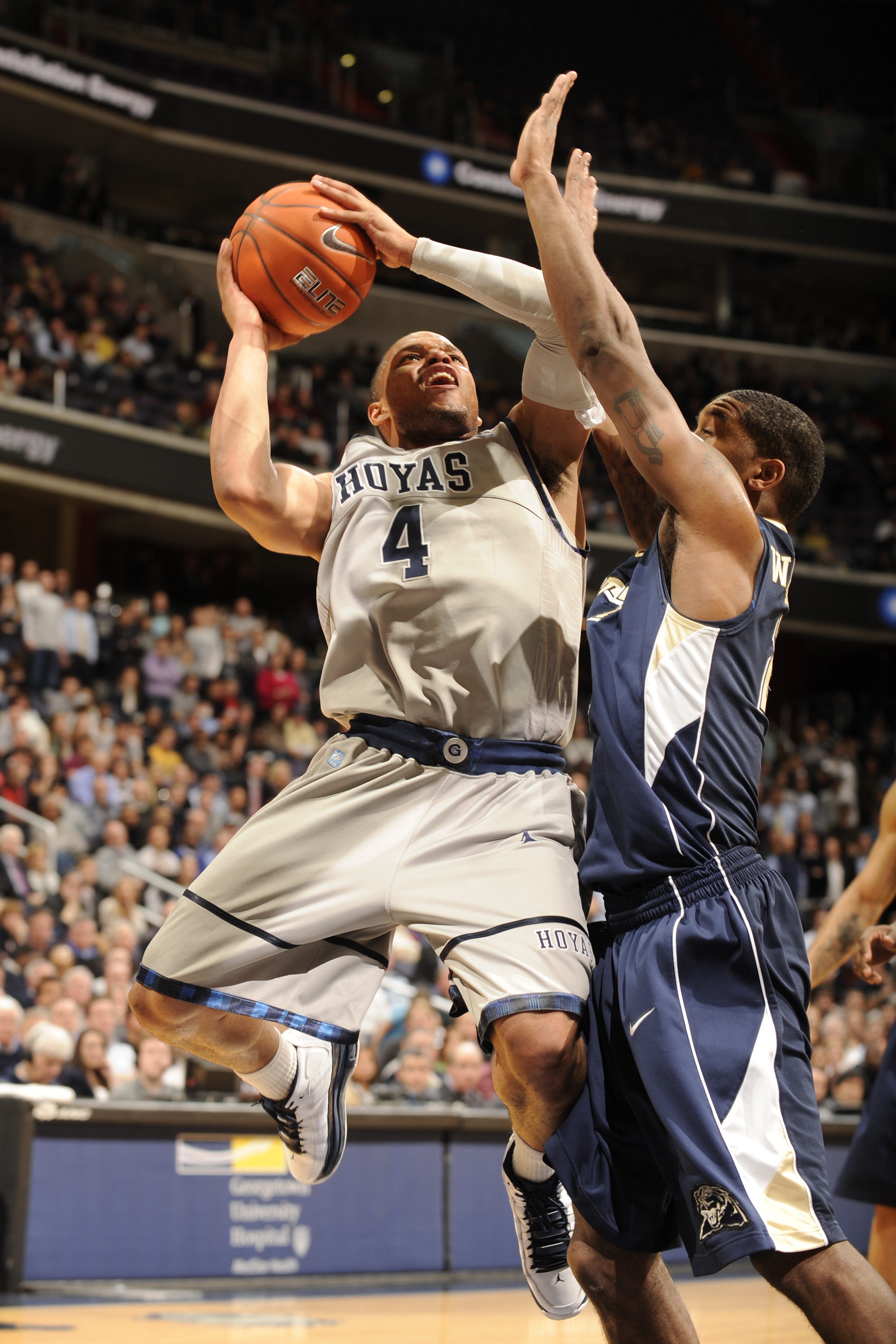 WASHINGTON, DC- JANUARY 12:  Chris Wright #4 of the Georgetown Hoya drives to basket during a college basketball game against the Pittsburgh Panthers on January 12, 2011 at the Verizon Center in Washington, DC.   The Panthers won 72-57.  (Photo by Mitchel