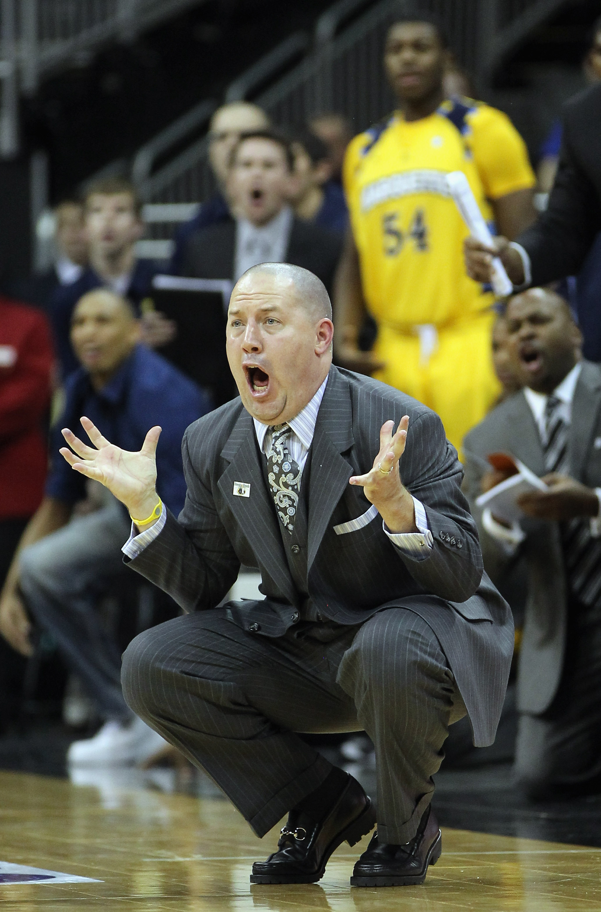 KANSAS CITY, MO - NOVEMBER 23:  Head coach Buzz Williams of the Marquette Golden Eagles reacts to a call during the CBE Classic consolation game against the Gonzaga Bulldogs on November 23, 2010 at the Sprint Center in Kansas City, Missouri.  (Photo by Ja