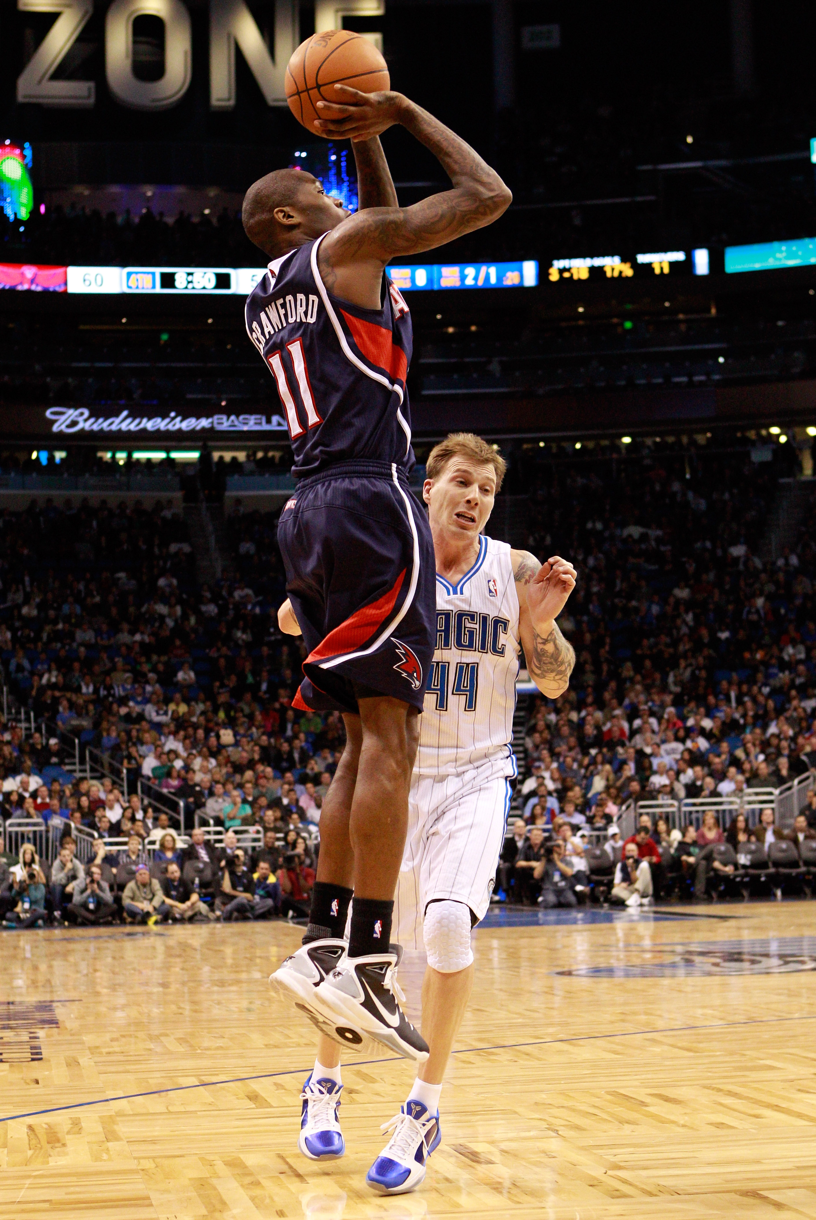 ORLANDO, FL - DECEMBER 06:  Jamal Crawford #11 of the Atlanta Hawks shoots over Jason Williams #44 of the Orlando Magic during the game at Amway Arena on December 6, 2010 in Orlando, Florida. NOTE TO USER: User expressly acknowledges and agrees that, by d