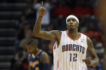 CHARLOTTE, NC - DECEMBER 07:  Tyrus Thomas #12 of the Charlotte Bobcats reacts to scoring against the Denver Nuggets during their game at Time Warner Cable Arena on December 7, 2010 in Charlotte, North Carolina.  NOTE TO USER: User expressly acknowledges
