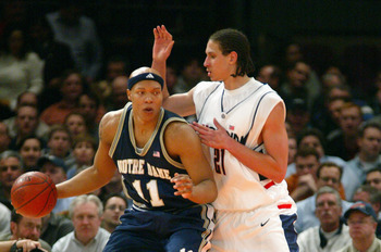 NEW YORK - MARCH 11:  Hilton Armstrong #11 of the Notre Dame Fighting Irish posts up Josh Boone #21 of the Connecticut Huskies during their Quarterfinal game of the Big East Championship Tournament on March 11, 2004 at Madison Square Garden in New York Ci
