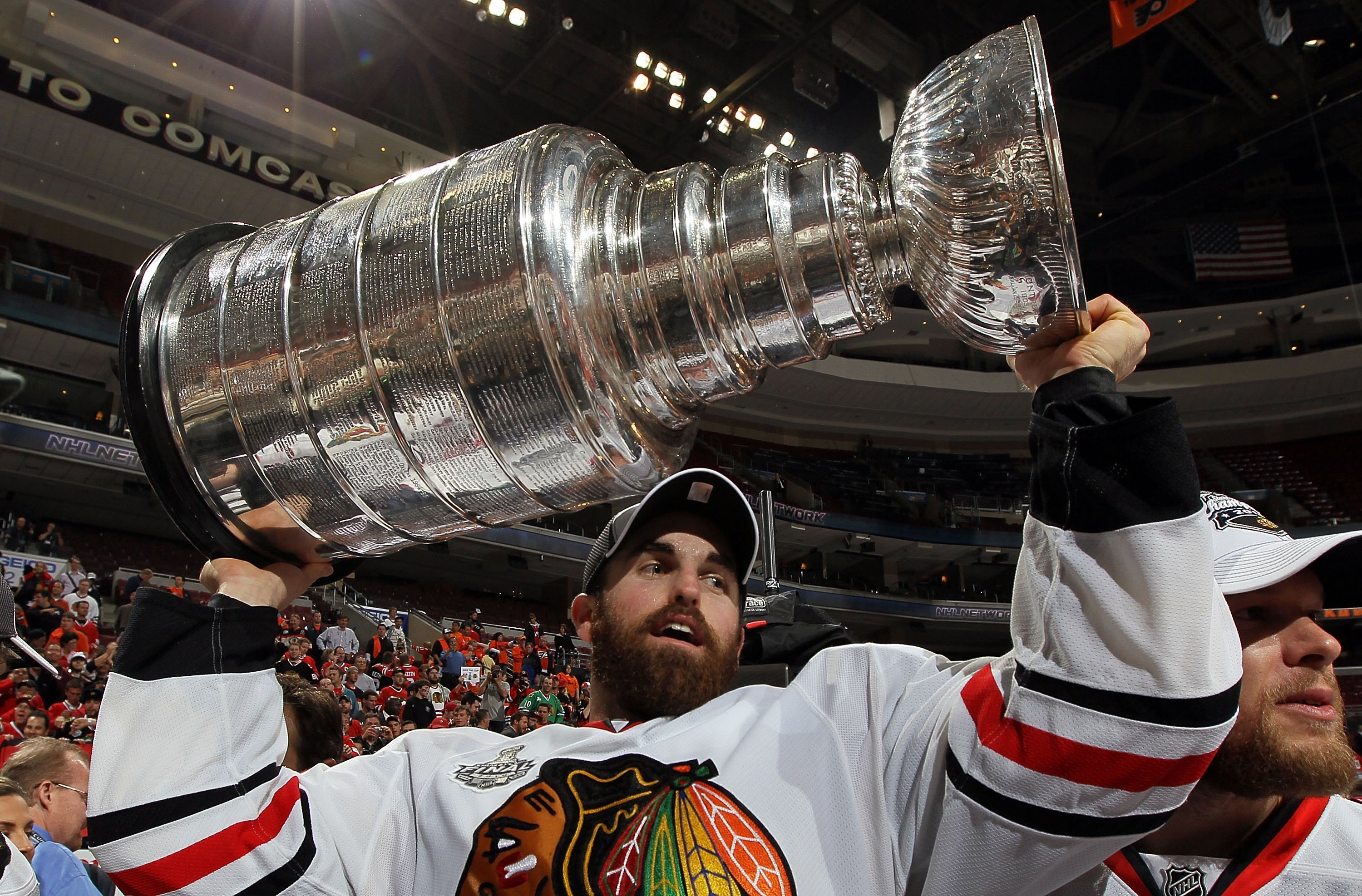 PHILADELPHIA - JUNE 09:  Andrew Ladd #16 of the Chicago Blackhawks hoists the Stanley Cup after teammate Patrick Kane scored the game-winning goal in overtime to defeat the Philadelphia Flyers 4-3 and win the Stanley Cup in Game Six of the 2010 NHL Stanle