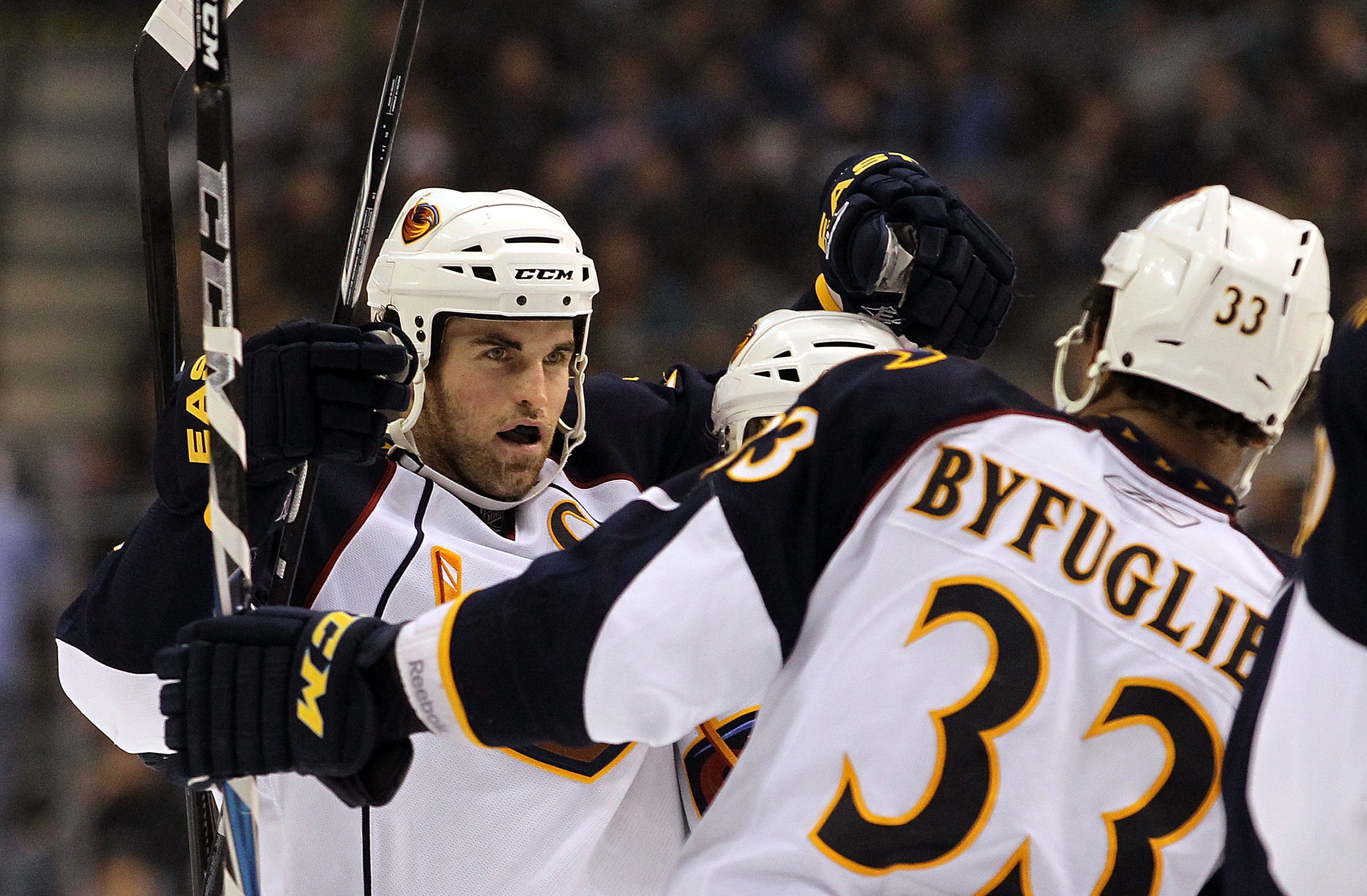 DALLAS, TX - JANUARY 15:  Andrew Ladd #16 celebrates his goal with Dustin Byfuglien #3 of the Atlanta Thrashers during play against the Dallas Stars at American Airlines Center on January 15, 2011 in Dallas, Texas.  (Photo by Ronald Martinez/Getty Images)