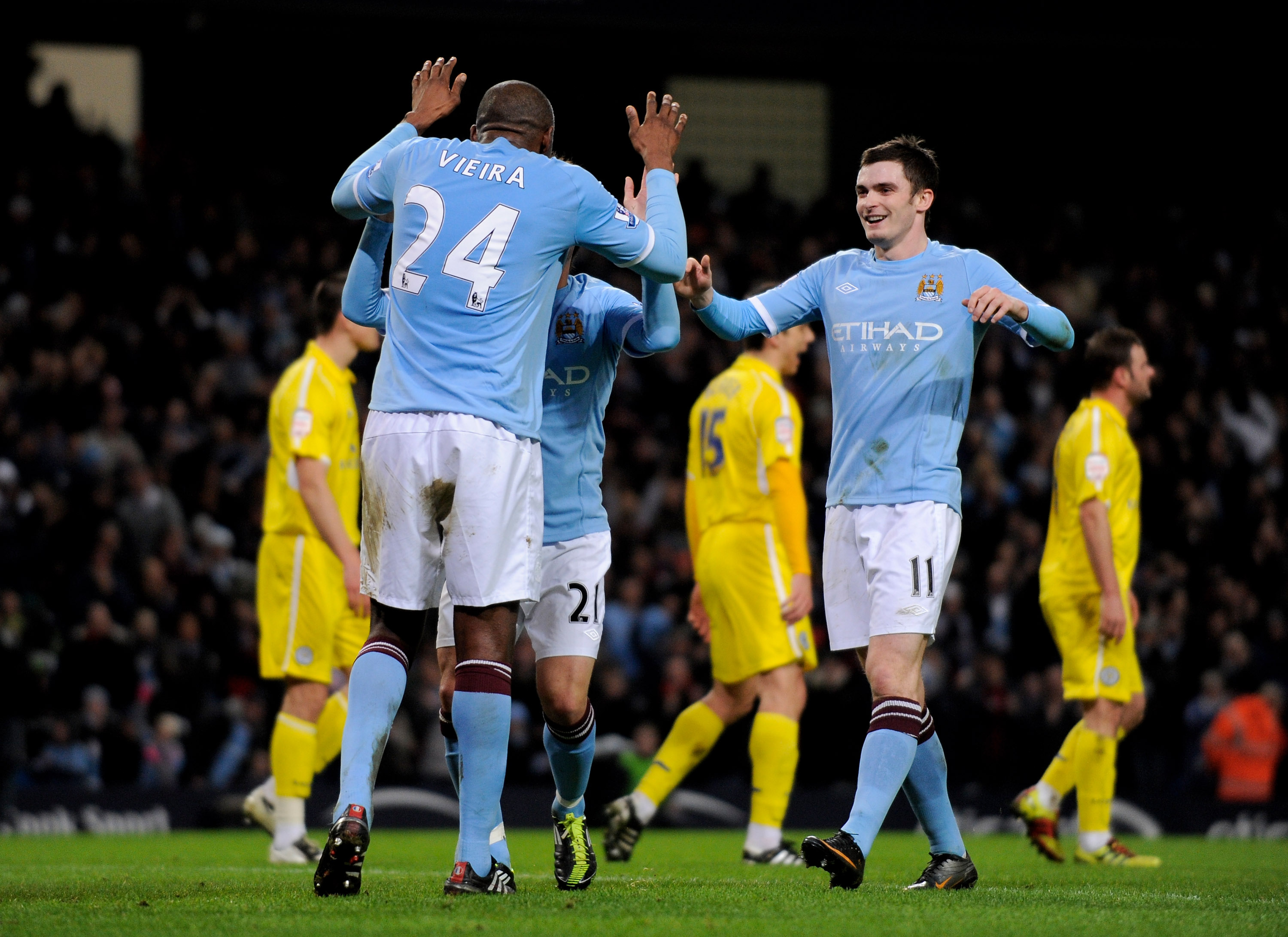 MANCHESTER, ENGLAND - JANUARY 18:  Patrick Viera of Manchester City celebrates scoring his team's second goal with his team mates during the FA Cup sponsored by E.On Third Round Replay match between Manchester City and Leicester City at the City of Manche
