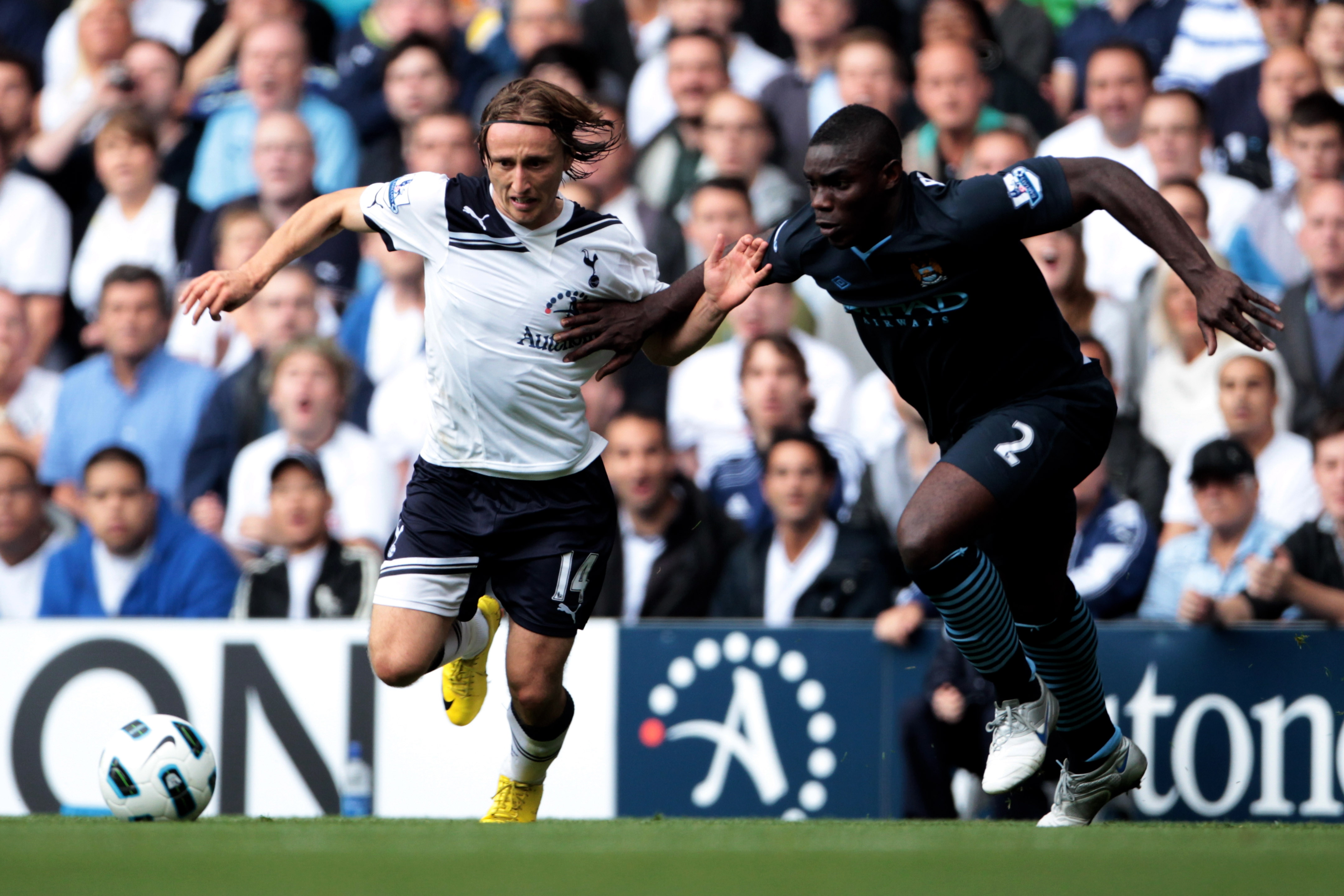 LONDON, ENGLAND - AUGUST 14:  Luka Modric of Tottenham battles with Micah Richards of Manchester City during the Barclays Premier League match between Tottenham Hotspur and Manchester City at White Hart Lane on August 14, 2010 in London, England.  (Photo