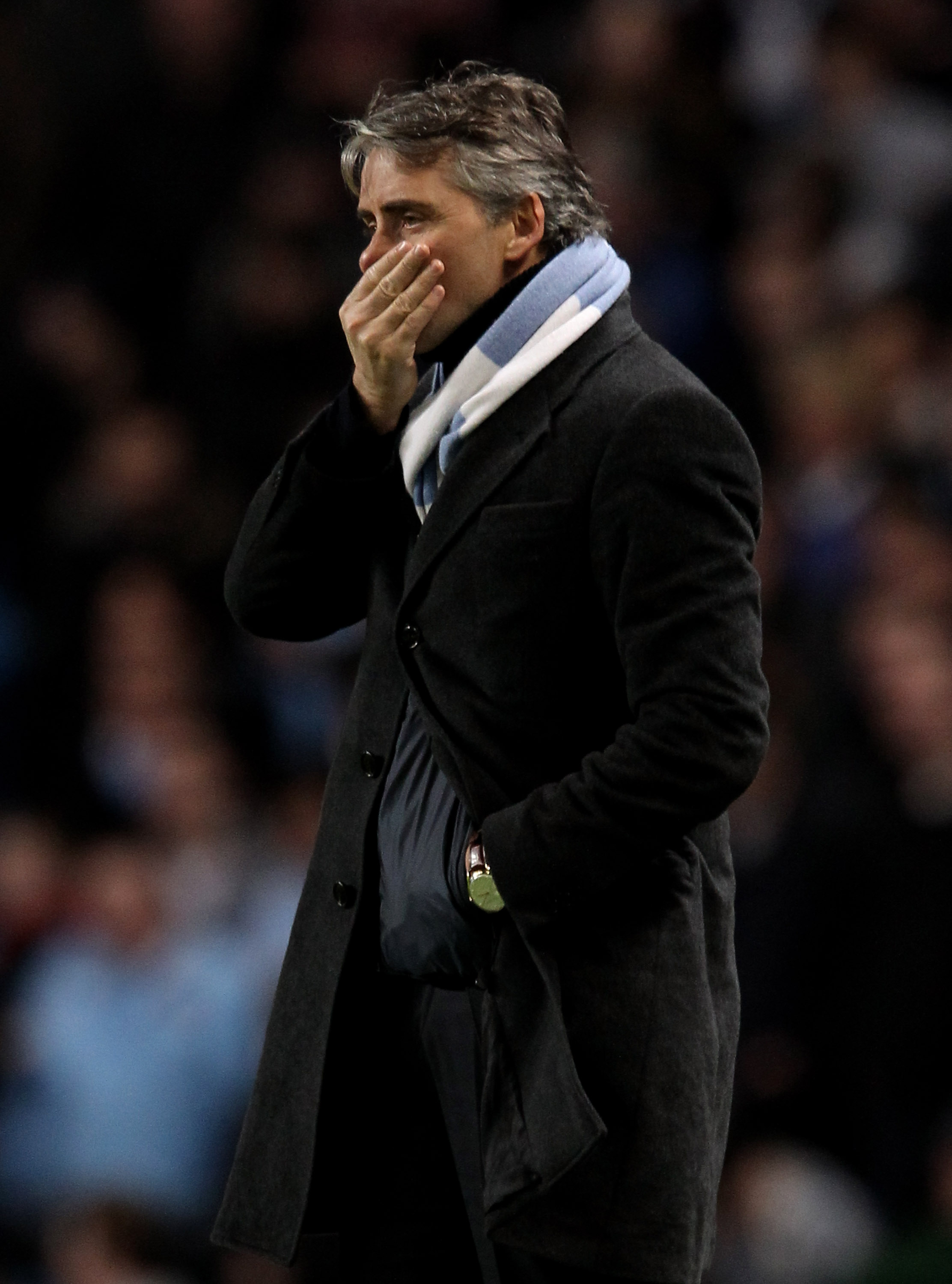 MANCHESTER, ENGLAND - JANUARY 15:  Manchester City Manager Roberto Mancini looks on during the Barclays Premier League match between Manchester City and Wolverhampton Wanderers at the City of Manchester Stadium on January 15, 2011 in Manchester, England.