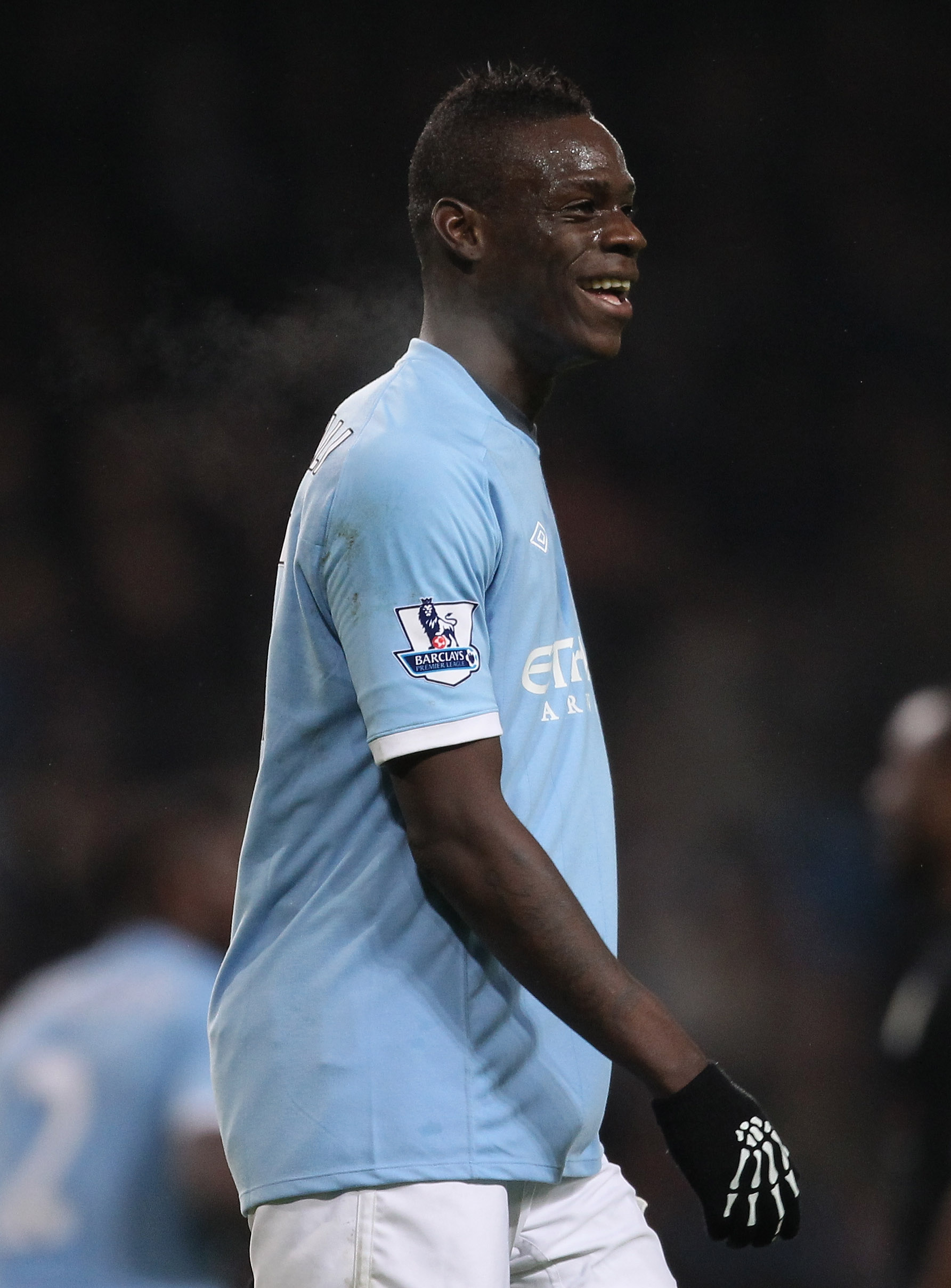 MANCHESTER, ENGLAND - DECEMBER 28:  Mario Balotelli of Manchester City smiles after scoring his third goal during the Barclays Premier League match between Manchester City and Aston Villa at the City of Manchester Stadium on December 28, 2010 in Mancheste