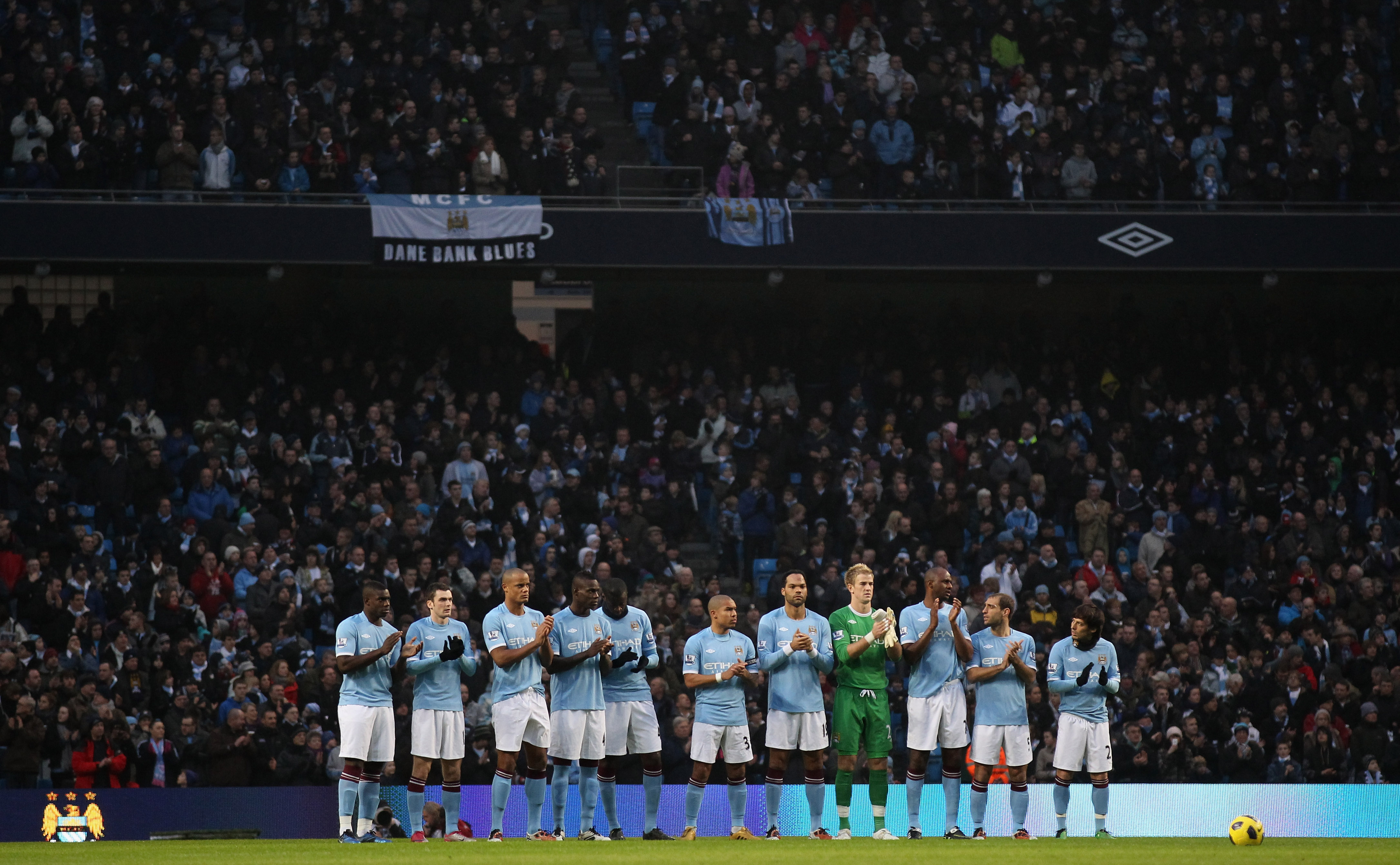 MANCHESTER, ENGLAND - DECEMBER 28: Players of Manchester City observe a one minute's applause in memory of all the people connected with the club who have lost their lives over the past year prior to the Barclays Premier League match between Manchester Ci