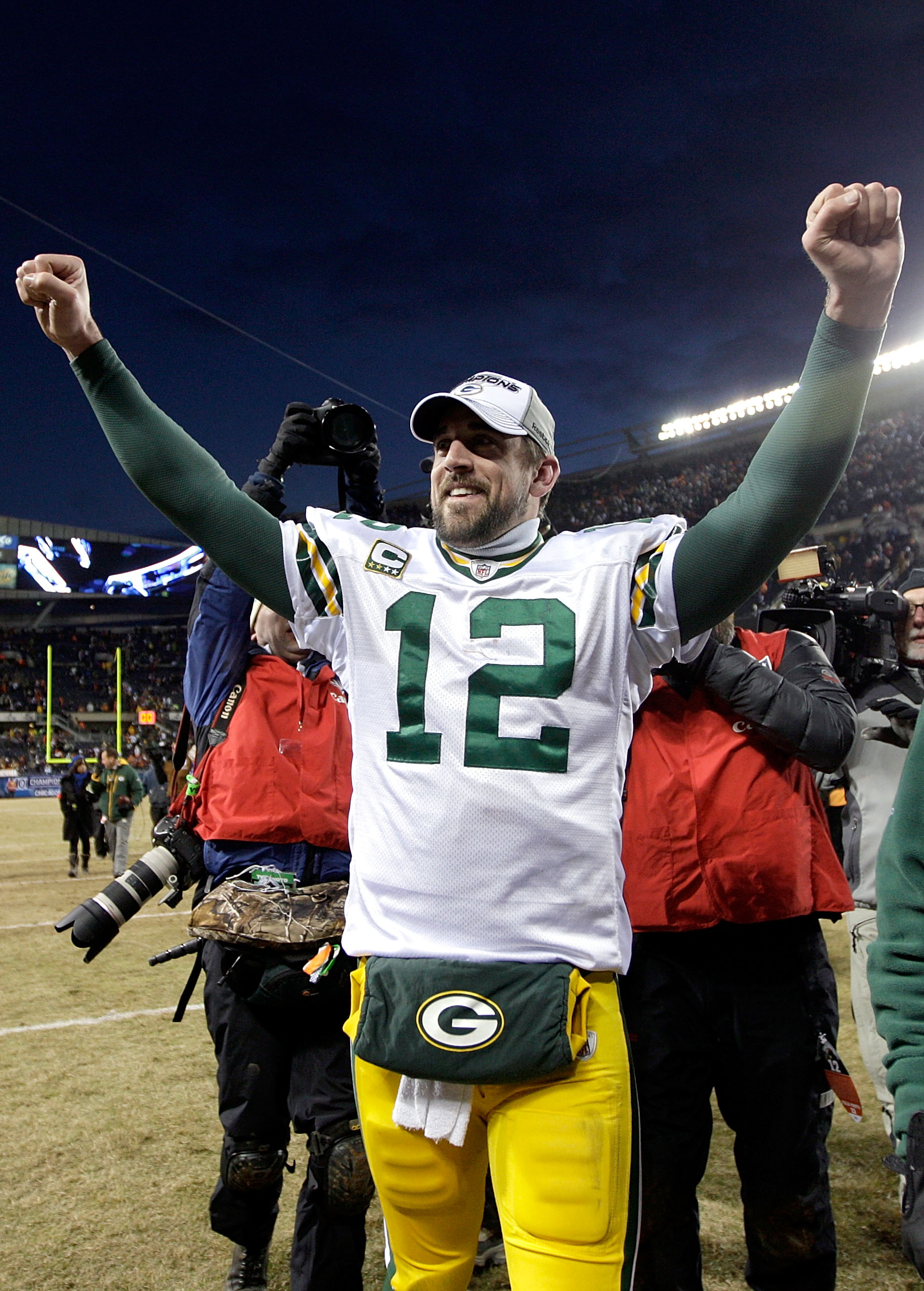 CHICAGO, IL - JANUARY 23:  Quarterback Aaron Rodgers #12 of the Green Bay Packers celebrates the Packers 21-14 victory against the Chicago Bears in the NFC Championship Game at Soldier Field on January 23, 2011 in Chicago, Illinois.  (Photo by Jamie Squir