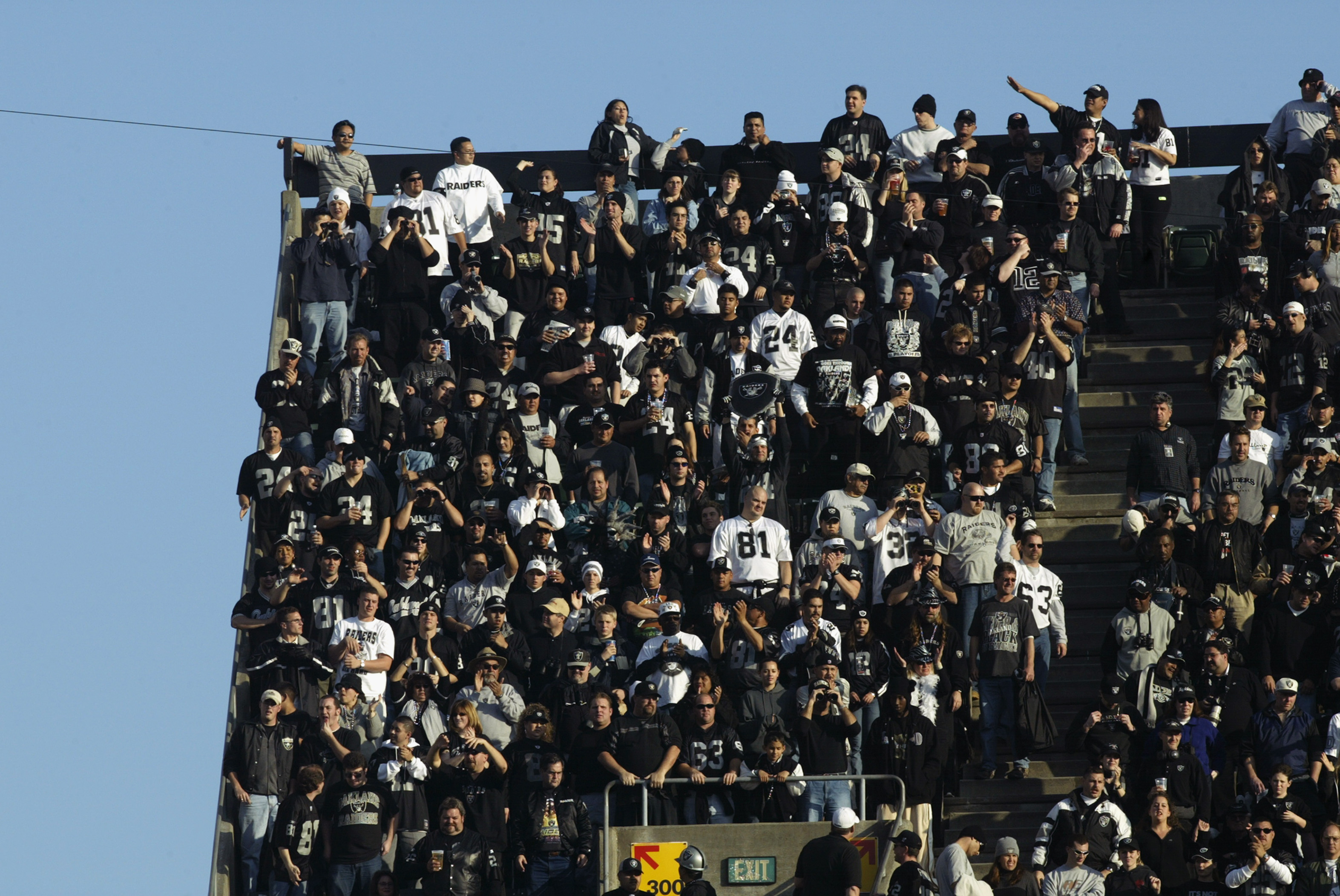 OAKLAND, CA - JANUARY 19:  Fans of the Oakland Raiders fill even the 'nose-bleed' seats during the AFC Championship game against the Tennessee Titans at Network Associates Coliseum on January 19, 2003 in Oakland, California.  The Raiders defeated the Tita