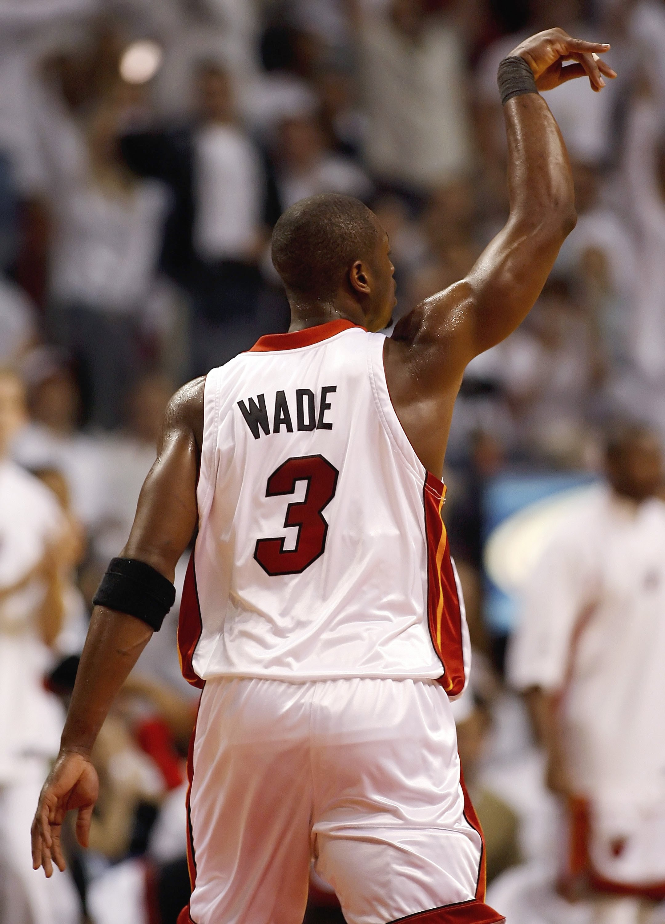 MIAMI - JUNE 2:  Dwyane Wade #3 of the Miami Heat reacts to a basket against the Detroit Pistons in game six of the Eastern Conference Finals during the 2006 NBA Playoffs on June 2, 2006 at American Airlines Arena in Miami, Florida.  NOTE TO USER: User ex