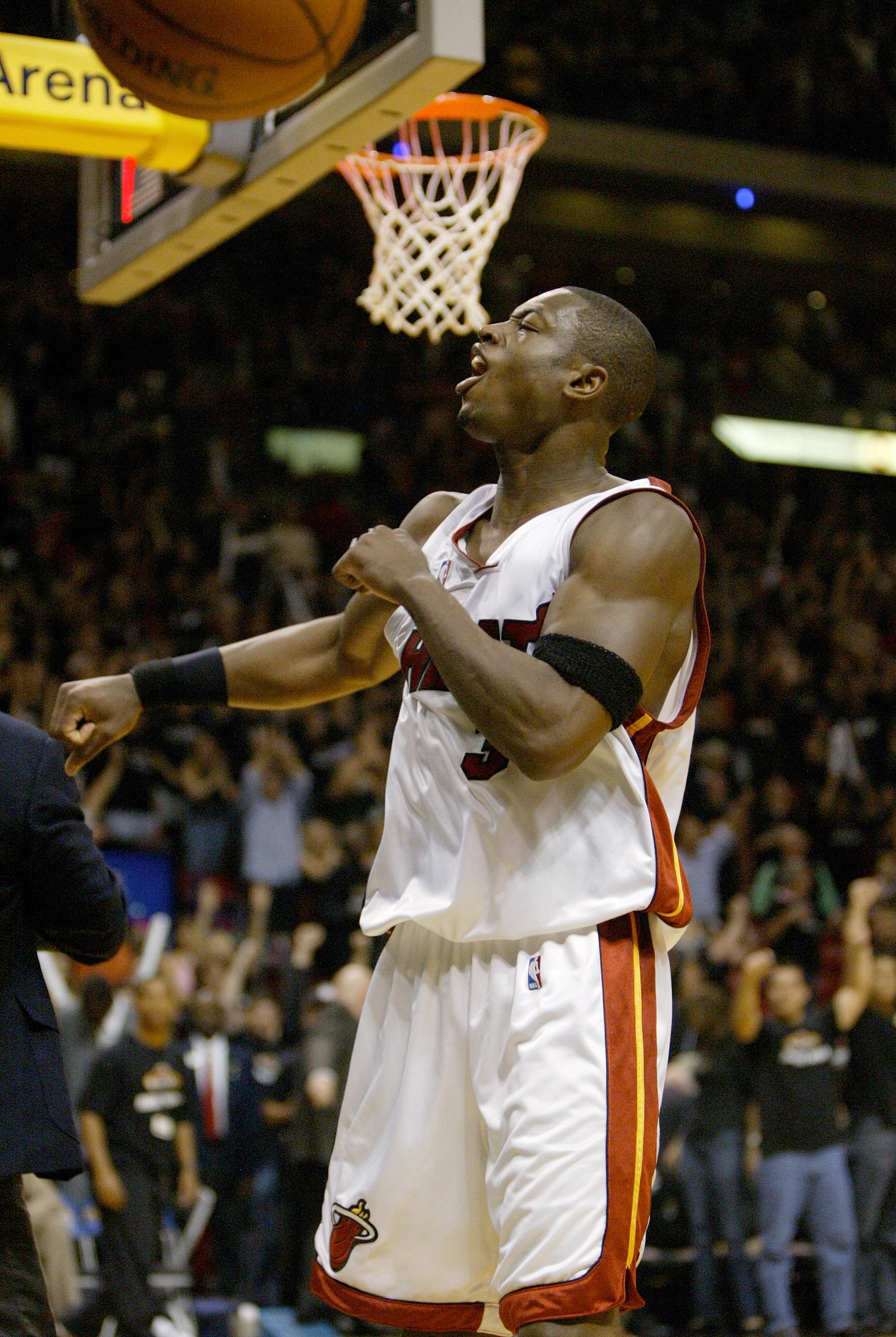 MIAMI - APRIL 18:  Dwyane Wade #3 of the Miami Heat celebrates after the game after hitting the final shot to win 81-79 against the New Orleans Hornets during game one, round one of the 2004 NBA Playoffs April 18, 2004 at the American Airlines Arena in Mi