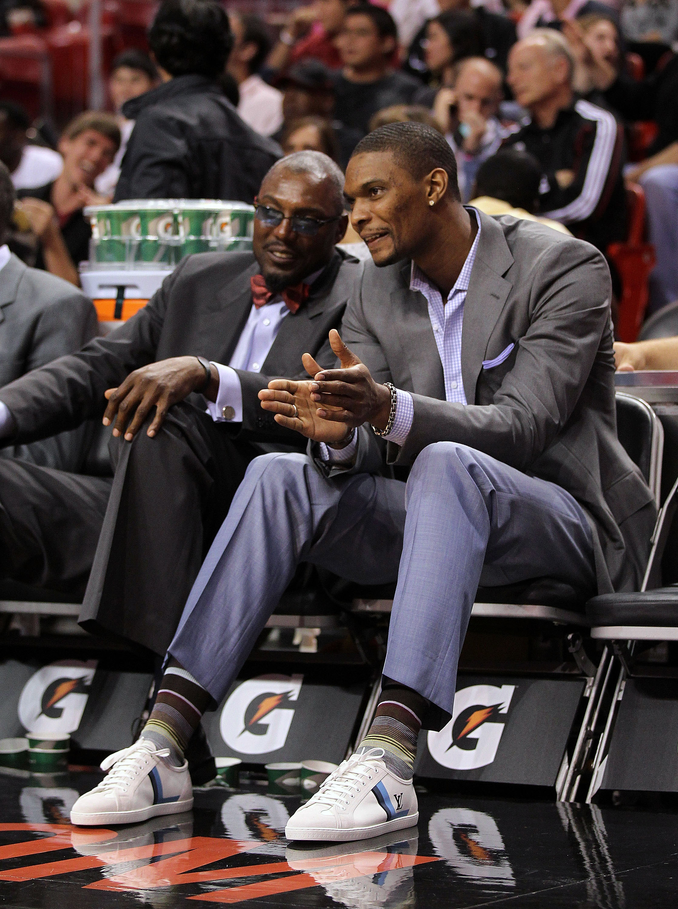 MIAMI, FL - JANUARY 22: Chris Bosh #1 of the Miami Heat talks with assistant coach Keith Askins during a game against the Toronto Raptors at American Airlines Arena on January 22, 2011 in Miami, Florida. NOTE TO USER: User expressly acknowledges and agree