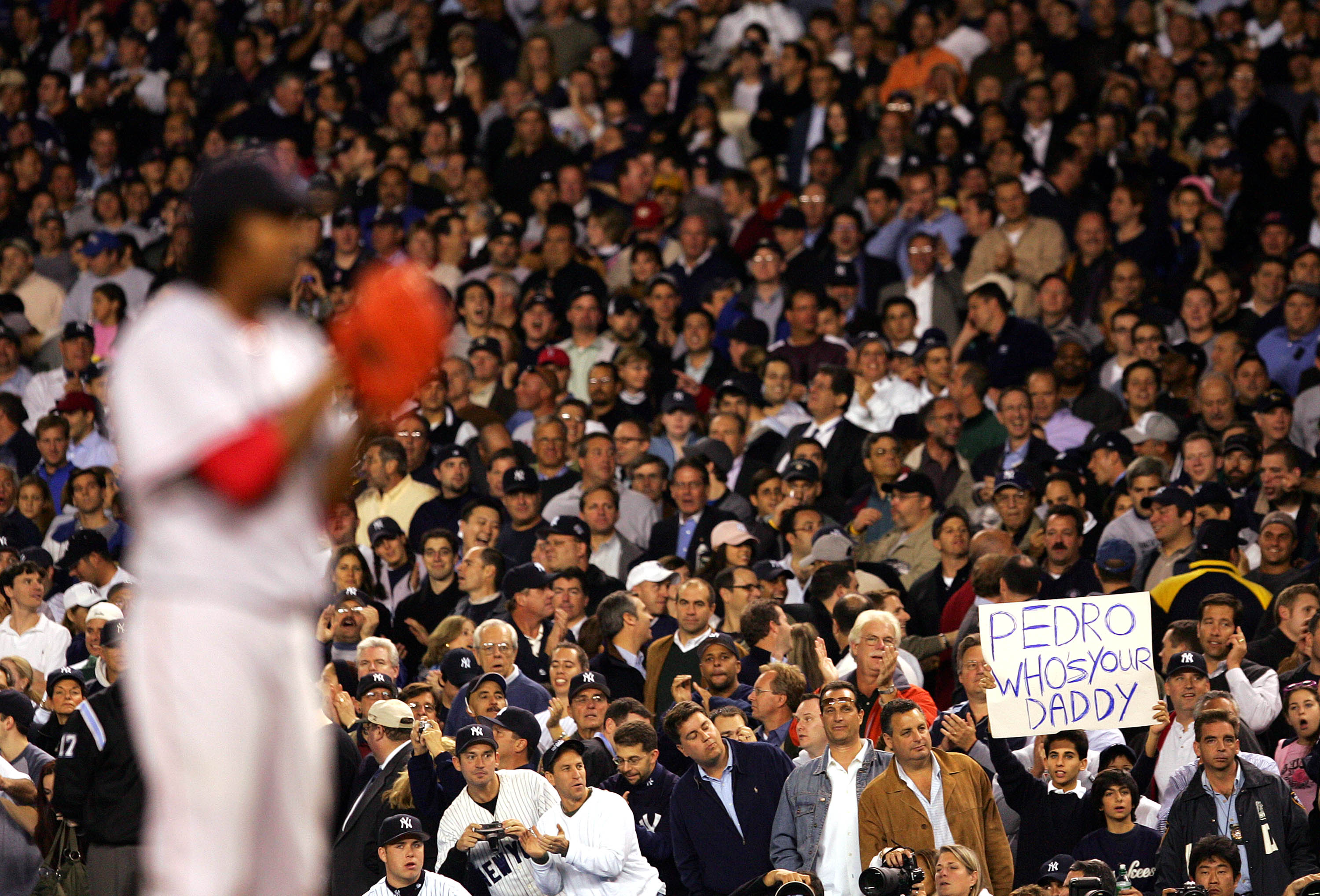 NEW YORK - OCTOBER 13:  A New York Yankees fan holds up a sign that reads 'Who's Your Daddy?' as pitcher Pedro Martinez #45 of the Boston Red Sox prepares to pitch in the sixth inning during game two of the American League Championship Series on October 1