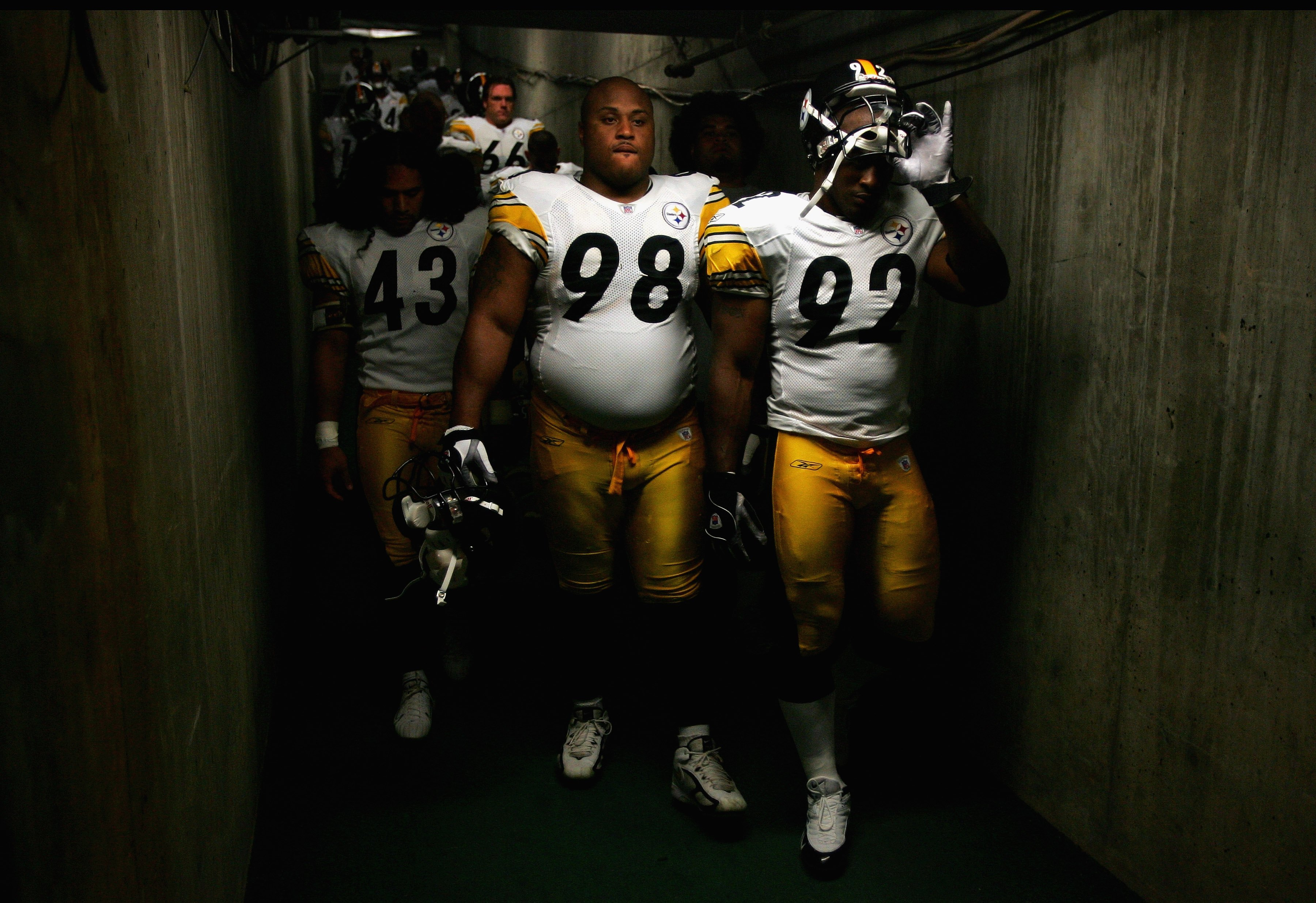 SAN DIEGO - OCTOBER 08:  Troy Polamalu #43, Casey Hampton #98, and James Harrison #92 of the Pittsburgh Steelers enter the game against the San Diego Chargers during the 1st half of their NFL game on October 8, 2006 at Qualcomm Stadium in San Diego, Calif
