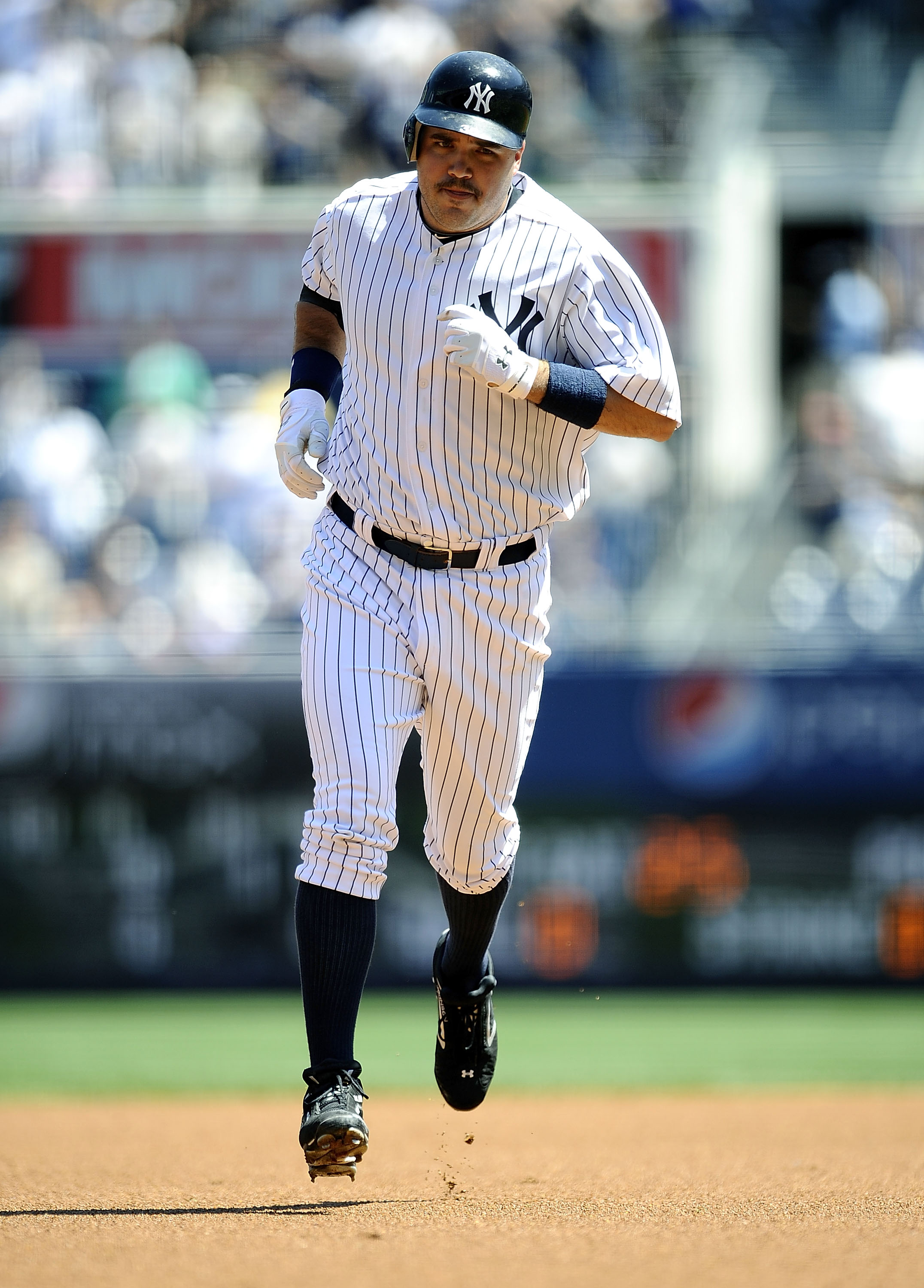 NEW YORK - MAY 05:  Nick Johnson #36 of the New York Yankees rounds the bases on a solo home run against the Baltimore Orioles at Yankee Stadium on May 5, 2010 in the Bronx borough of New York City  (Photo by Jeff Zelevansky/Getty Images)