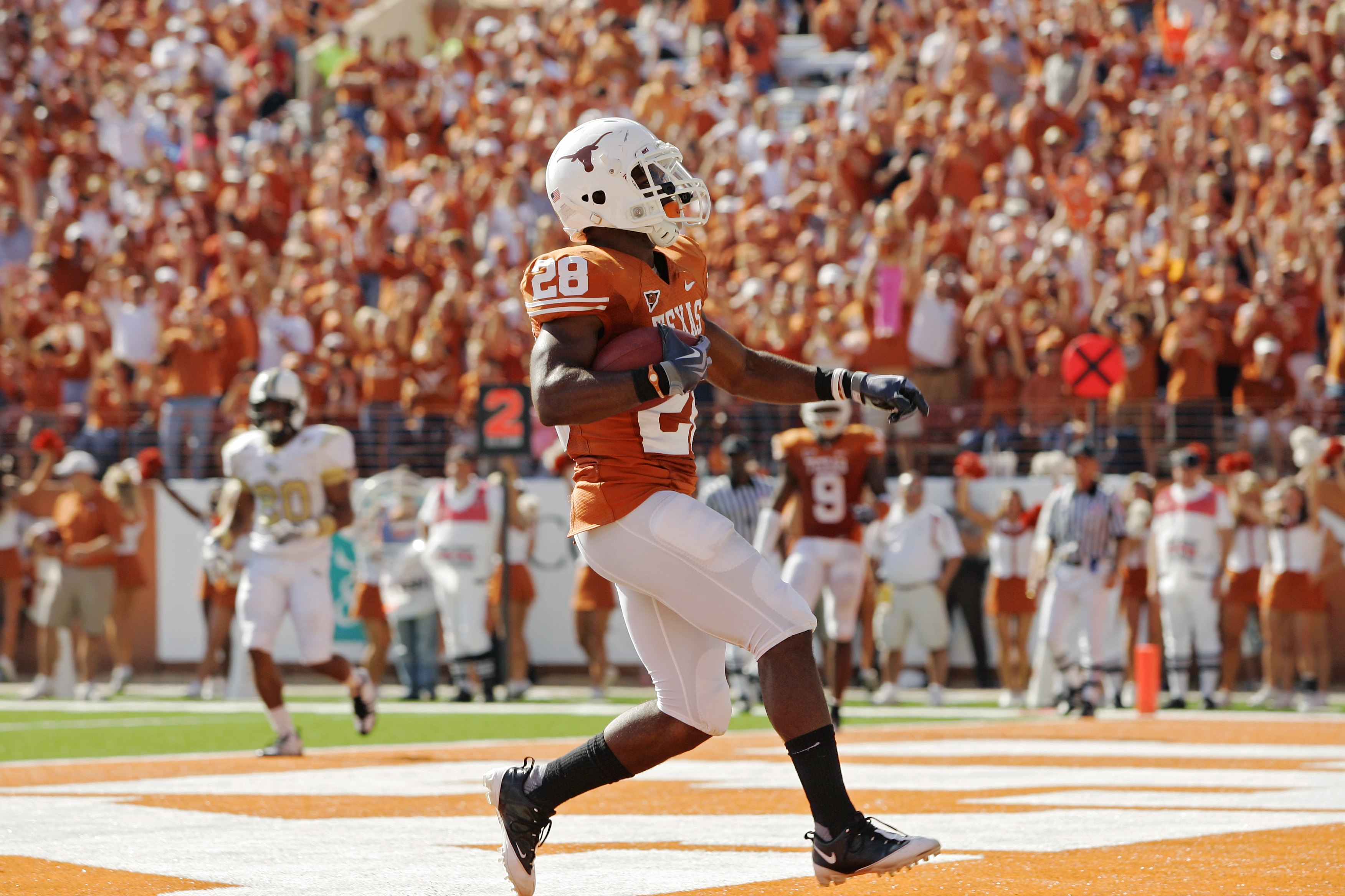 AUSTIN, TX - NOVEMBER 07:  Running back Fozzy Whittaker #28 of the Texas Longhorns scores a touchdown against the UCF Knights in the third quarter on November 7, 2009 at Darrell K Royal - Texas Memorial Stadium in Austin, Texas.  Texas won 35-3.  (Photo b