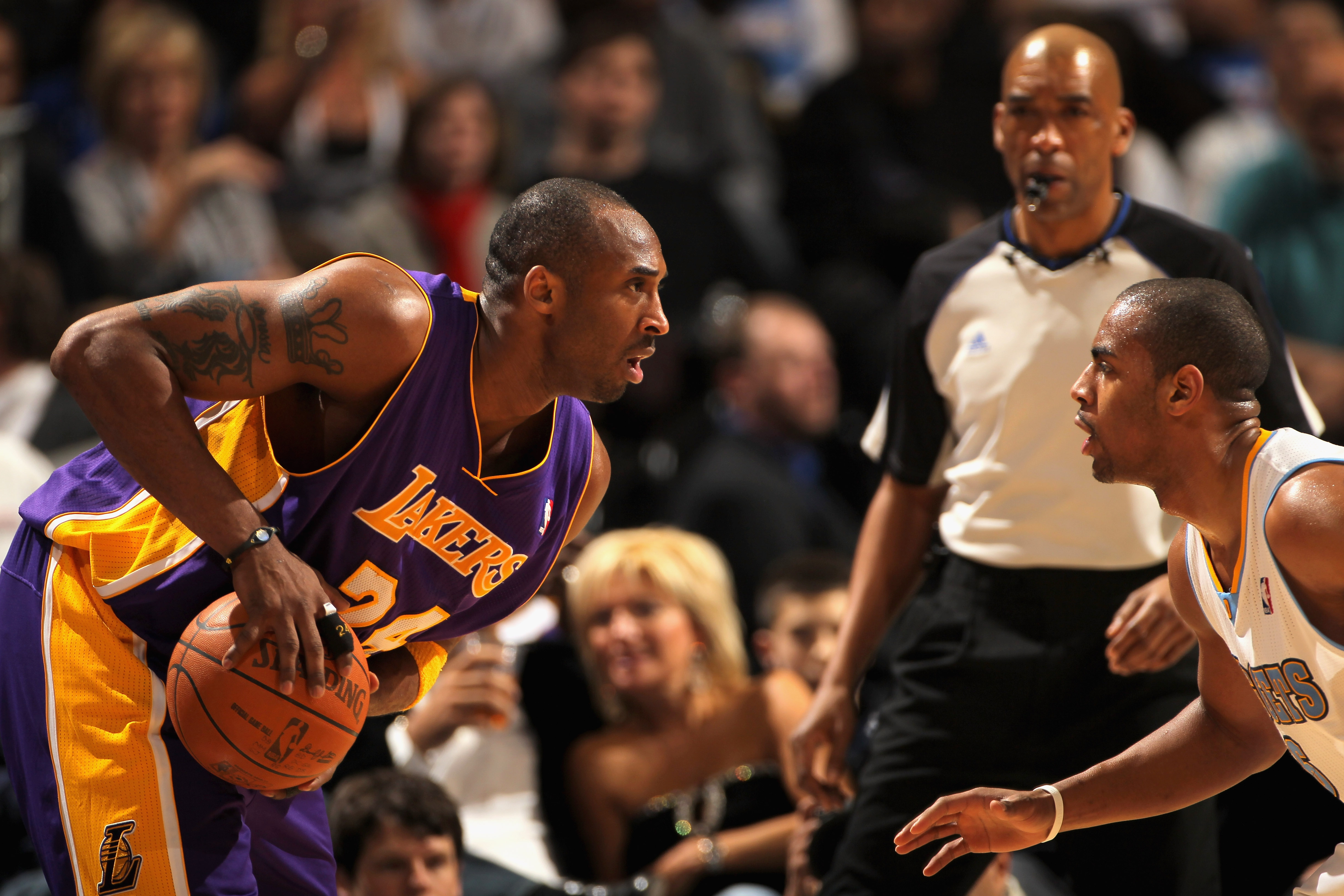 DENVER, CO - JANUARY 21:  Kobe Bryant #24 of the Los Angeles Lakers controls the ball against the defense of Arron Afflalo #6 of the Denver Nuggets at the Pepsi Center on January 21, 2011 in Denver, Colorado. The Lakers defeated the Nuggets 97-107. NOTE T