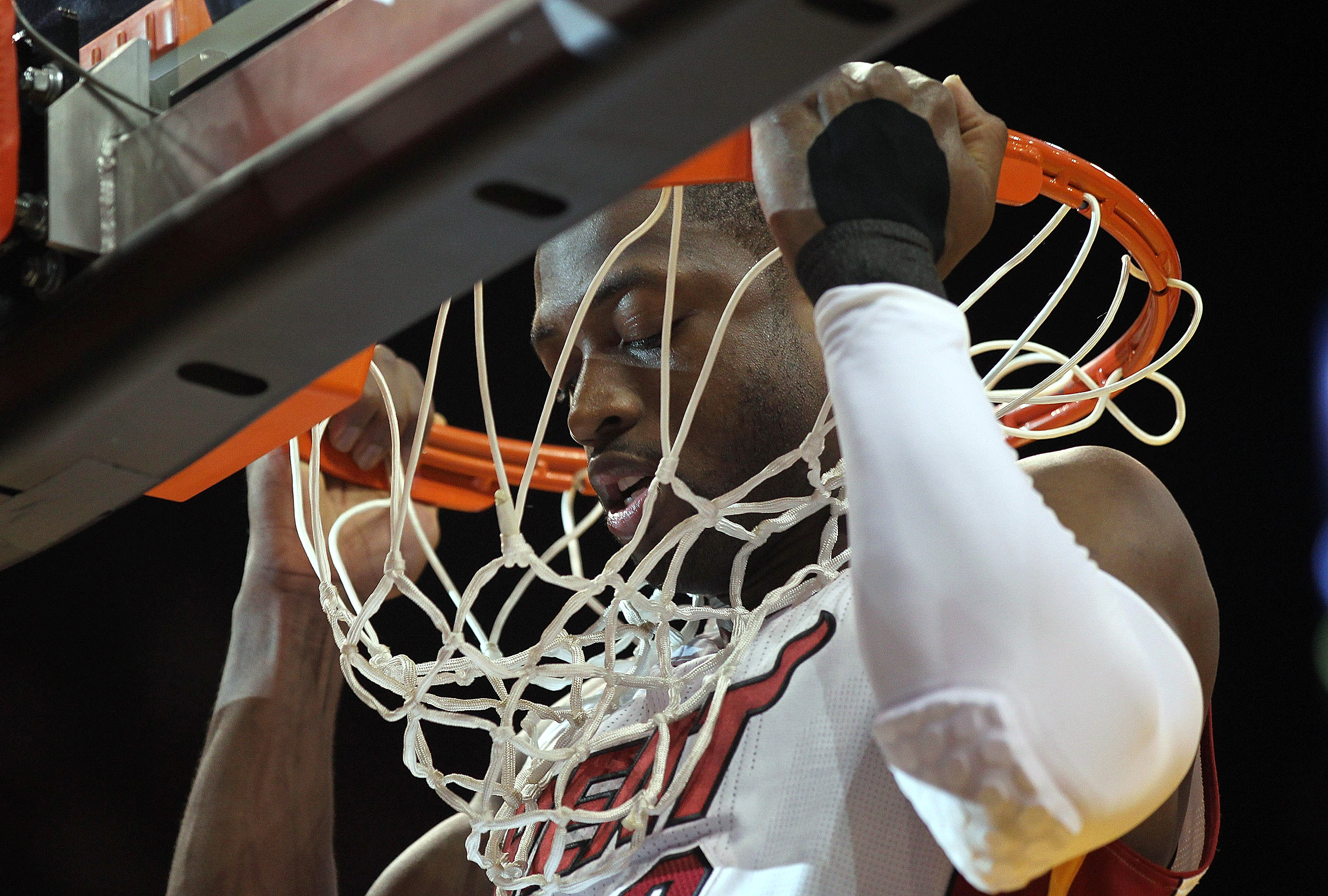 MIAMI, FL - JANUARY 18:  Dwyane Wade #3 of the Miami Heat does pullups on the rim during a game against the Atlanta Hawks at American Airlines Arena on January 18, 2011 in Miami, Florida. NOTE TO USER: User expressly acknowledges and agrees that, by downl