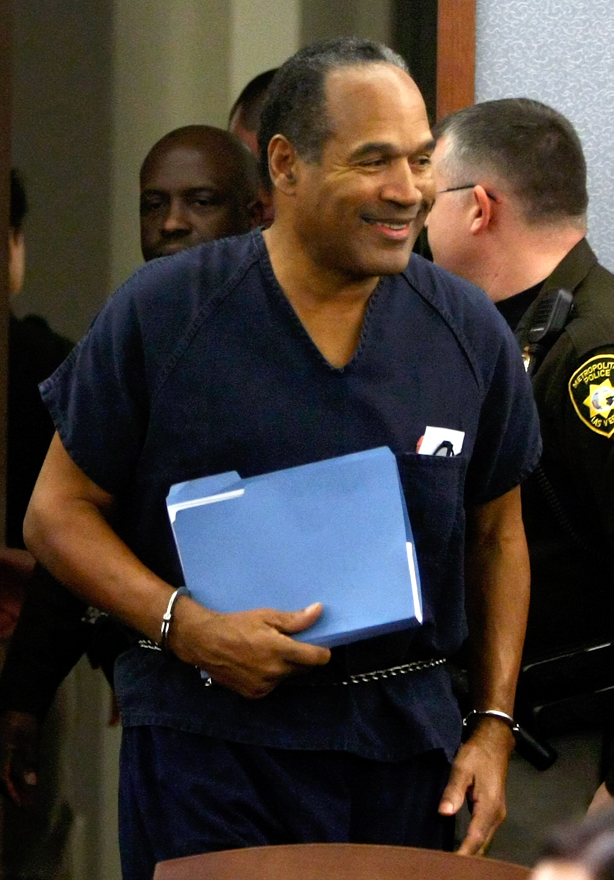 LAS VEGAS - DECEMBER 05:  O.J. Simpson smiles as he arrives in court for his sentencing hearing at the Clark County Regional Justice Center December 5, 2008 in Las Vegas, Nevada. Simpson and co-defendant Clarence 'C.J.' Stewart were sentenced on 12 charge
