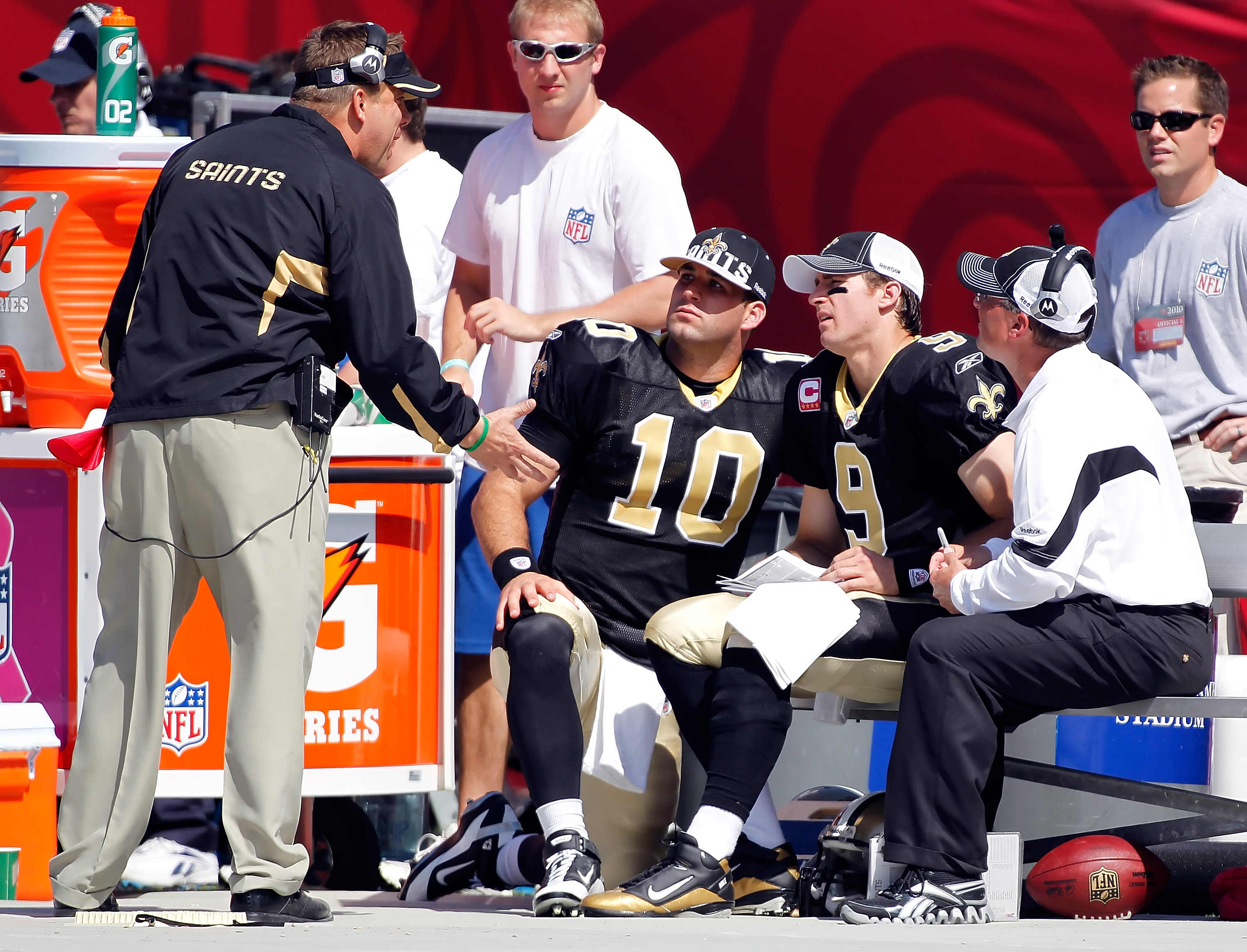 TAMPA, FL - OCTOBER 17:  Head coach Sean Payton of the New Orleans Saints talks with quarterbacks Chase Daniel #10 and Drew Brees #9 on the bench against the Tampa Bay Buccaneers during the game at Raymond James Stadium on October 17, 2010 in Tampa, Flori