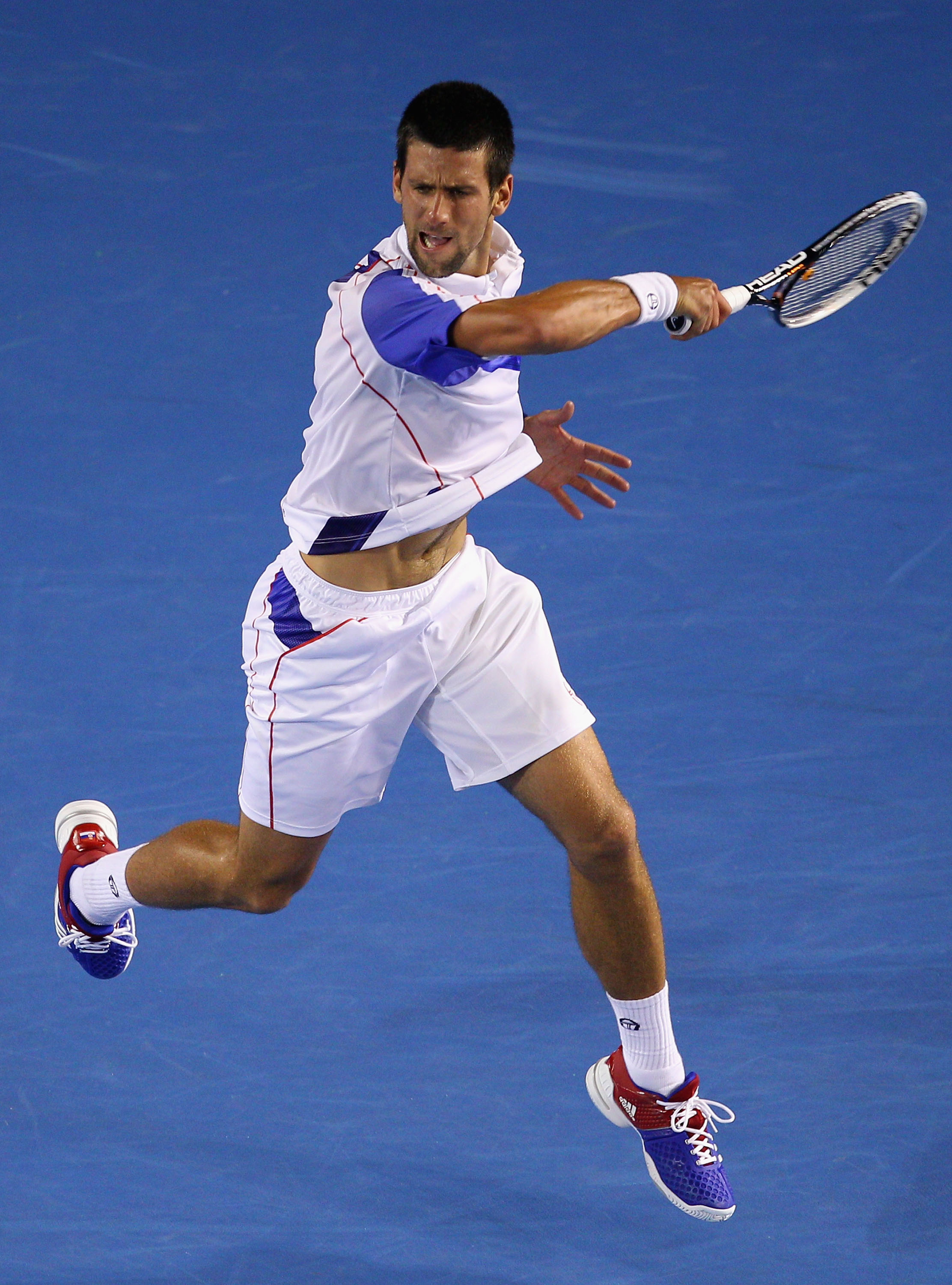 MELBOURNE, AUSTRALIA - JANUARY 25:  Novak Djokovic of Serbia plays a forehand in his quarterfinal match against Tomas Berdych of the Czech Republic  during day nine of the 2011 Australian Open at Melbourne Park on January 25, 2011 in Melbourne, Australia.