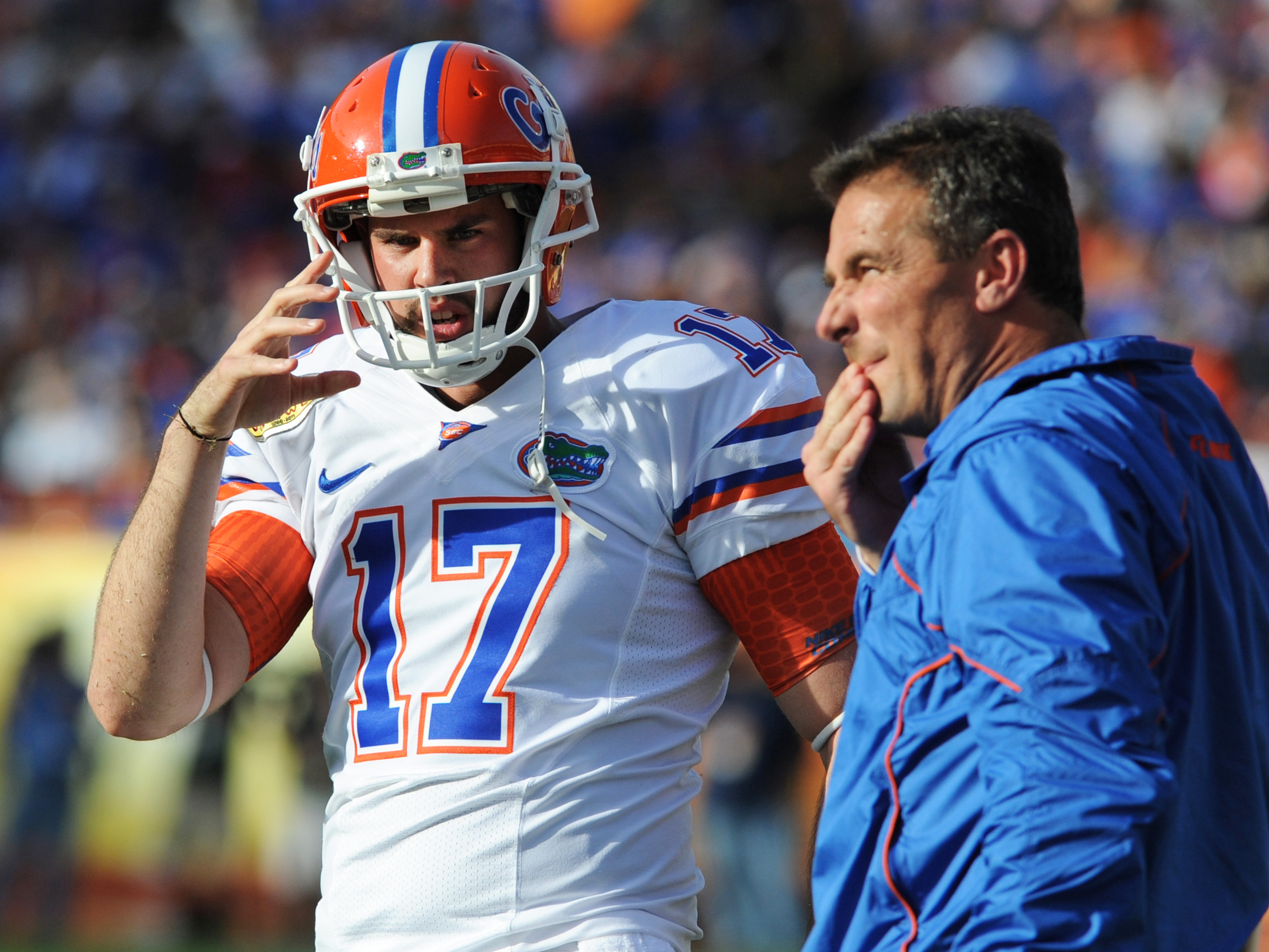 TAMPA, FL - JANUARY 1:  Kicker Chas Henry talks with coach Urban Meyer of the Florida Gators during play against the Penn State Nittany Lions January 1, 2010 in the 25th Outback Bowl at Raymond James Stadium in Tampa, Florida.  (Photo by Al Messerschmidt/