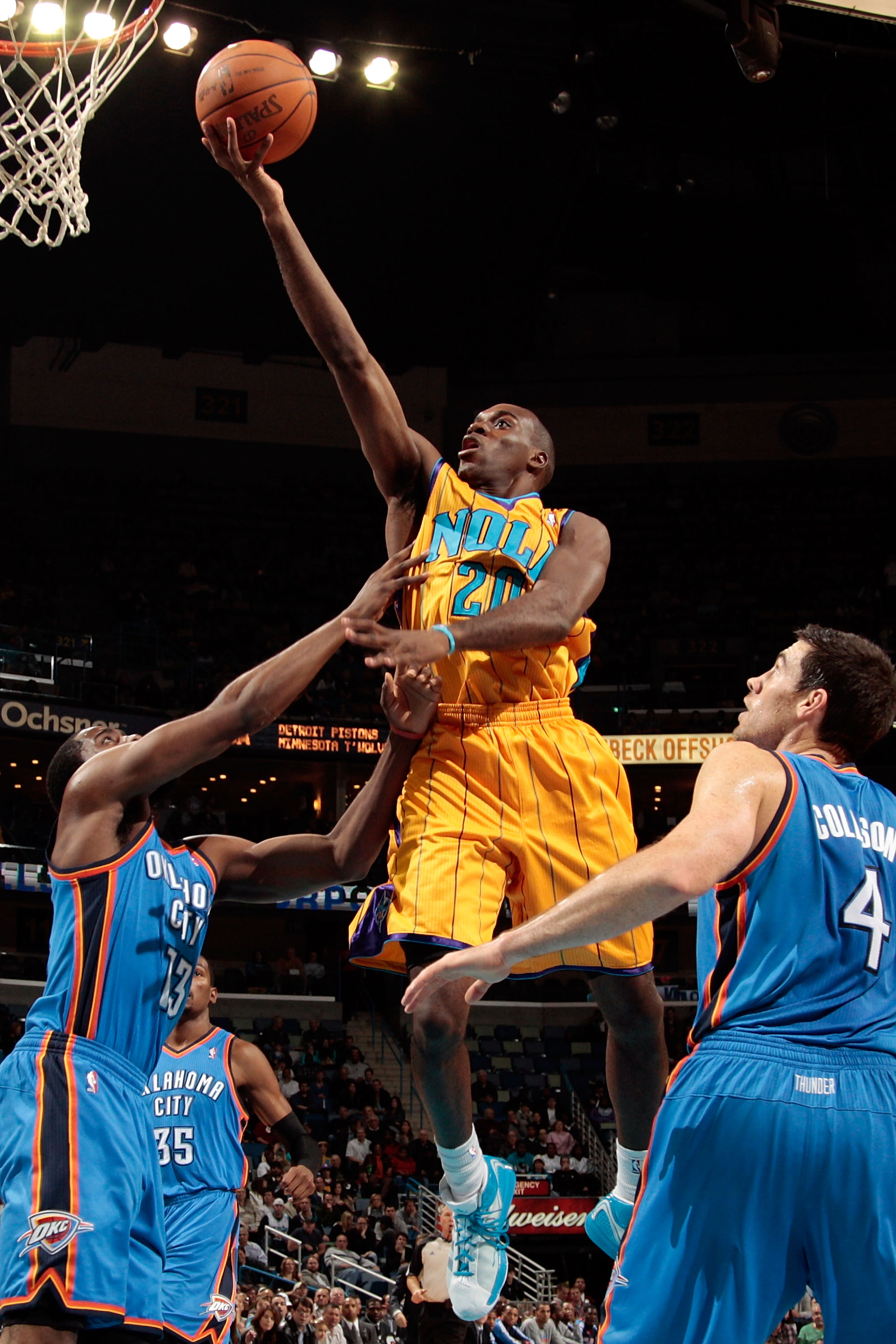 NEW ORLEANS, LA - DECEMBER 10:  Quincy Pondexter #20 of the New Orleans Hornets shoots the ball over James Harden #13 and Nick Collison #4 of the Oklahoma City Thunder at New Orleans Arena on December 10, 2010 in New Orleans, Louisiana.    NOTE TO USER: U