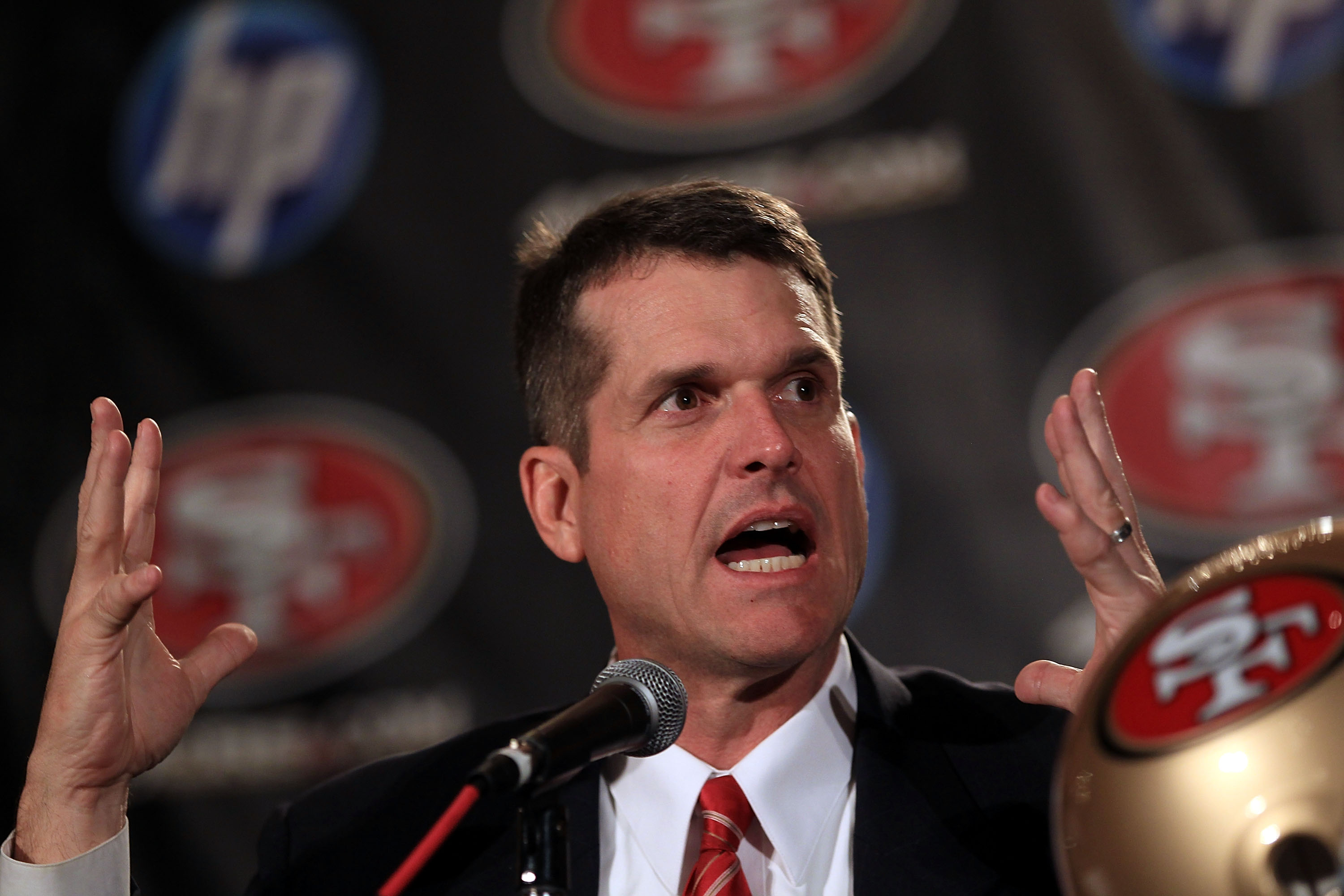 SAN FRANCISCO, CA - JANUARY 07:  Jim Harbaugh speaks at a press conference where he was introduced as the new San Francisco 49ers head coach at the Palace Hotel on January 7, 2011 in San Francisco, California.  (Photo by Ezra Shaw/Getty Images)