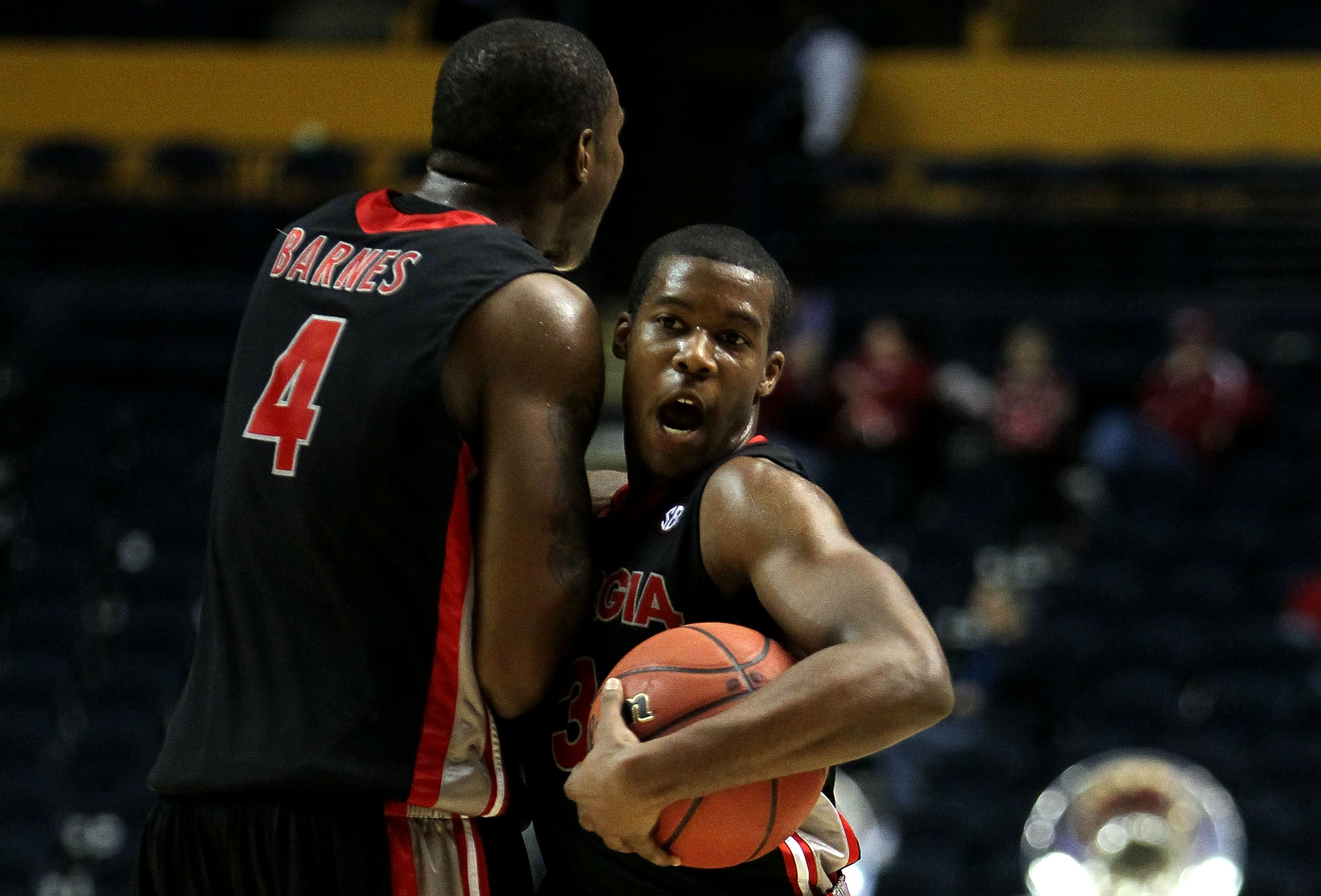 NASHVILLE, TN - MARCH 11:  Dustin Ware #3 and Chris Barnes #4 of the Georgia Bulldogs celebrate afte their 77-64 win against the Arkanasas Razorbacks during the first round of the SEC Men's Basketball Tournament at the Bridgestone Arena on March 11, 2010