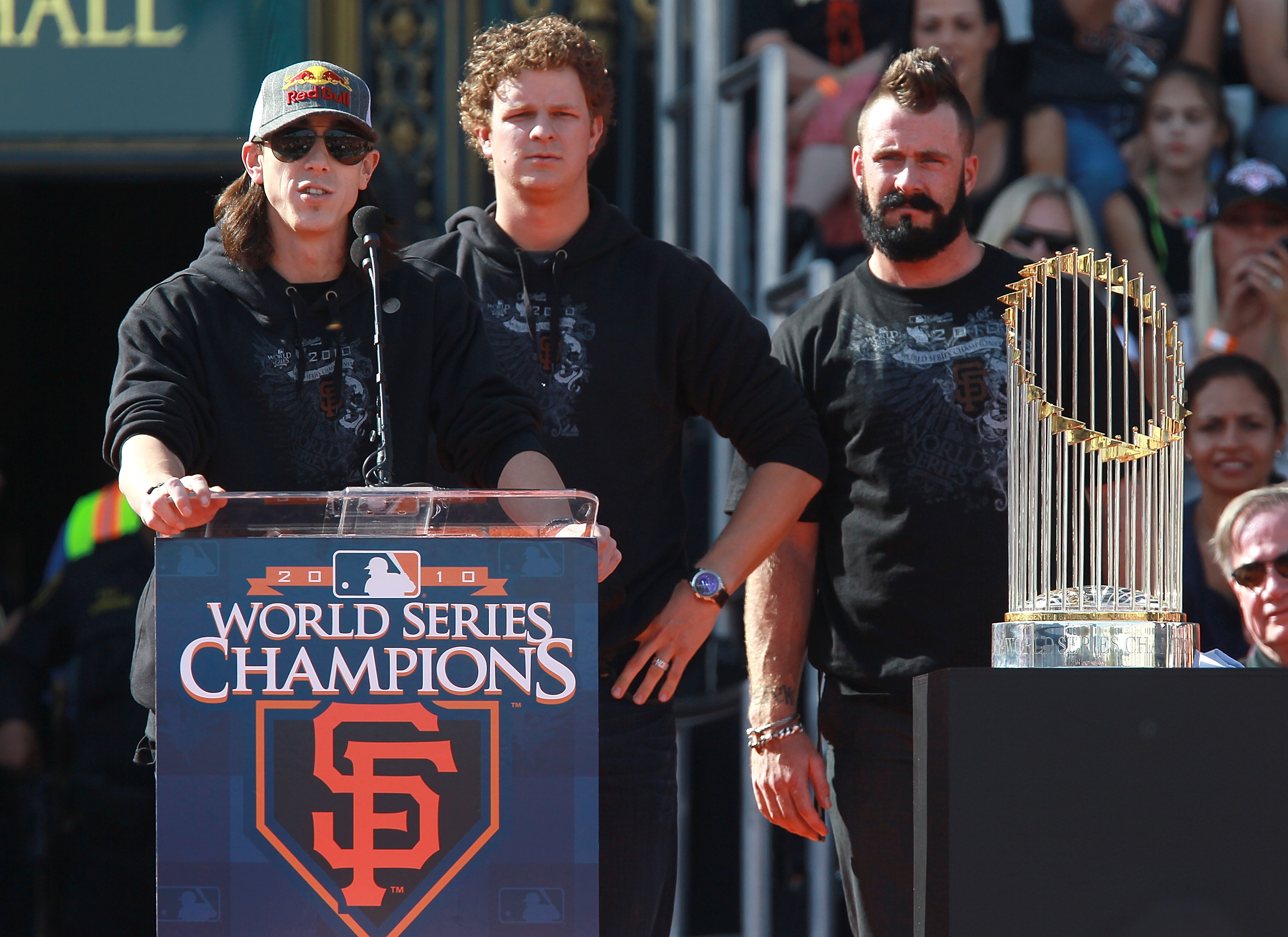 SAN FRANCISCO - NOVEMBER 03:  (L-R) San Francisco Giants pitchers Tim Lincecum, Matt Cain and Brian Wilson speak to fans outside San Francisco city hall during the Giants' victory parade and celebration on November 3, 2010 in San Francisco, California. Th