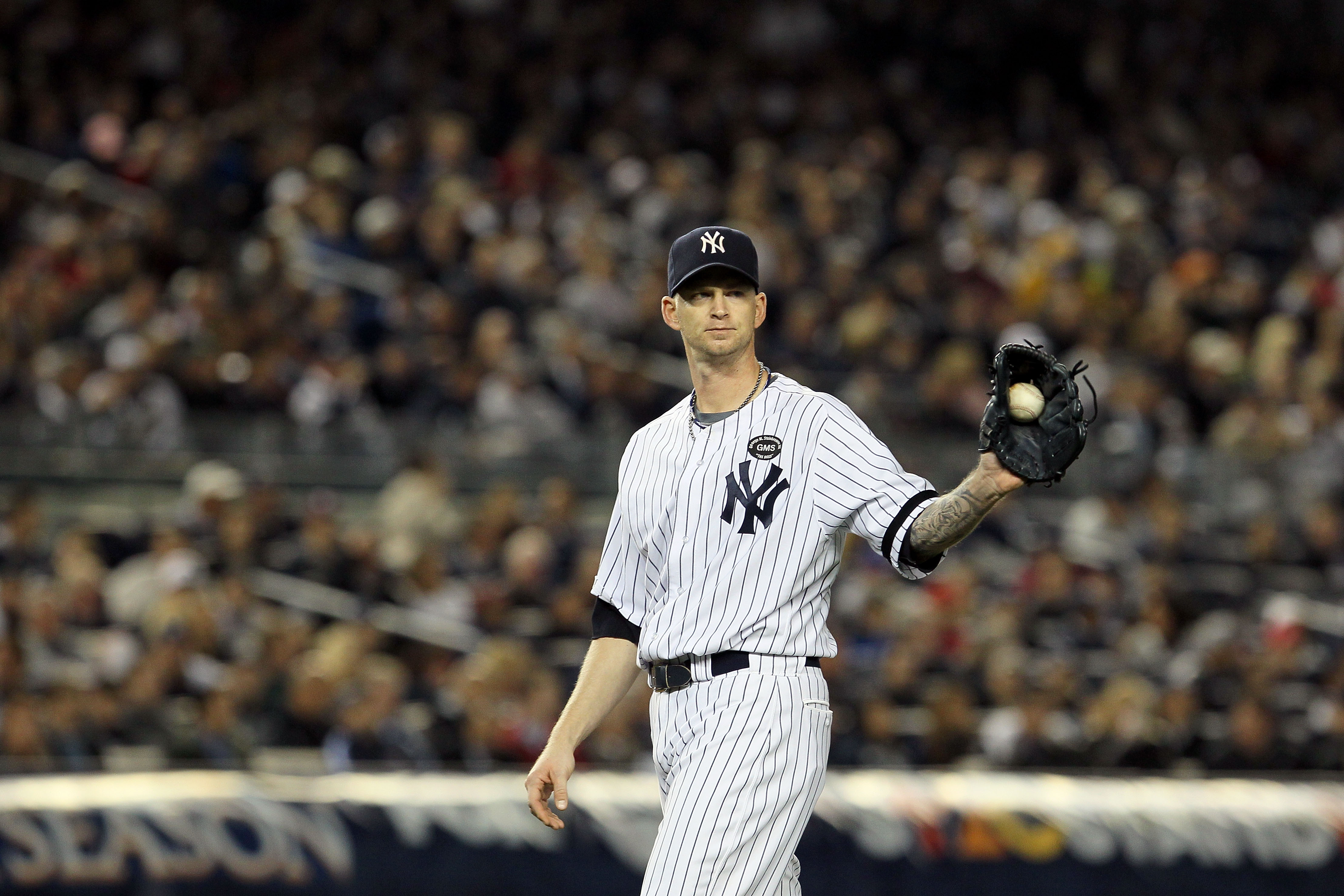 NEW YORK - OCTOBER 19:  A.J. Burnett #34 of the New York Yankees looks on against the Texas Rangers in Game Four of the ALCS during the 2010 MLB Playoffs at Yankee Stadium on October 19, 2010 in the Bronx borough of New York City.  (Photo by Jim McIsaac/G