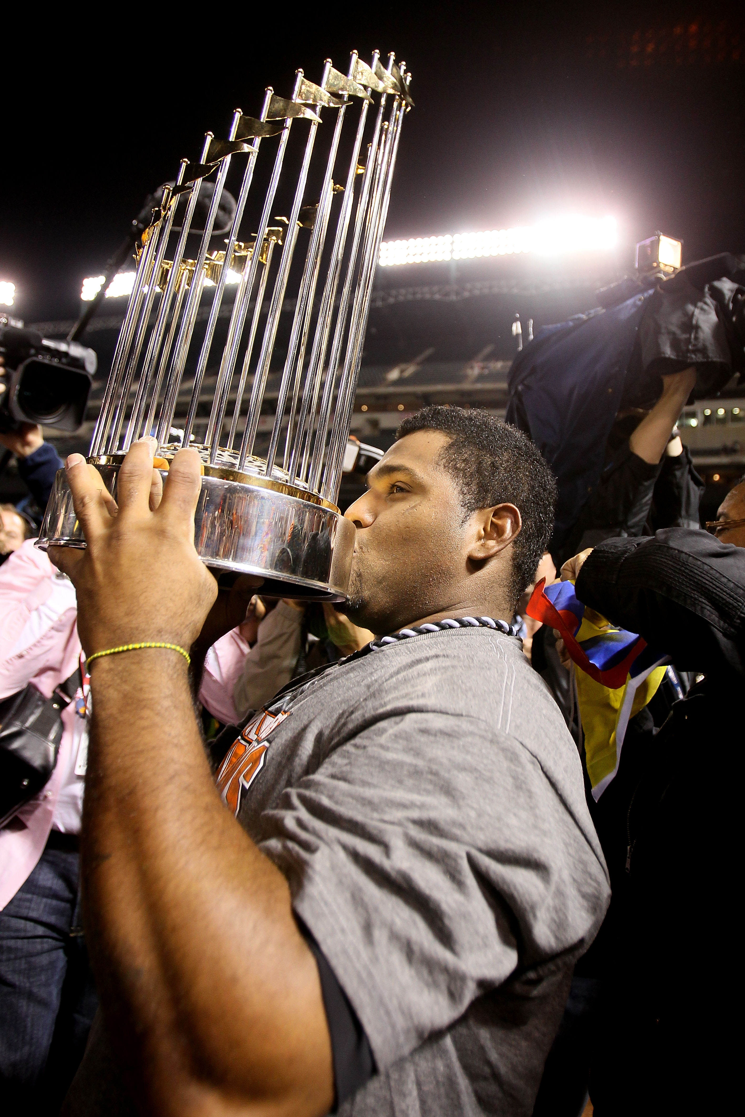ARLINGTON, TX - NOVEMBER 01:  Pablo Sandovalof the San Francisco Giants celebrates with the World Series Championship trophy after the Giants won 3-1 the Texas Rangers in Game Five of the 2010 MLB World Series at Rangers Ballpark in Arlington on November
