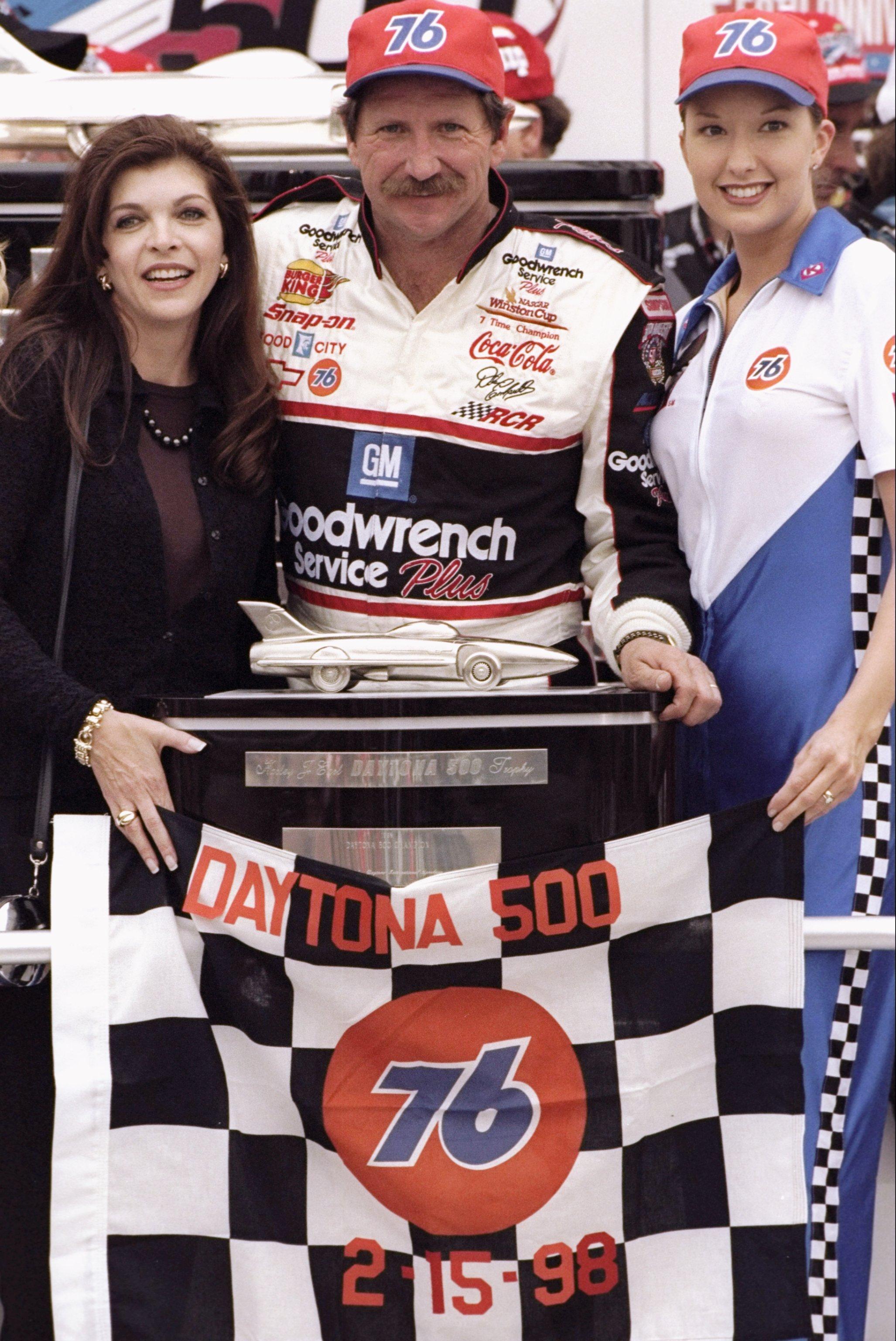 DAYTONA BEACH - FEBRUARY 15: Dale Earnhardt Sr. driver of the #3 GM Goodwrench Chevrolet celebrates with his wife Teresa after winning the Daytona 500 on February 15, 1998 at Daytona International Speedway in Daytona Beach, Florida. (Photo by David Taylor