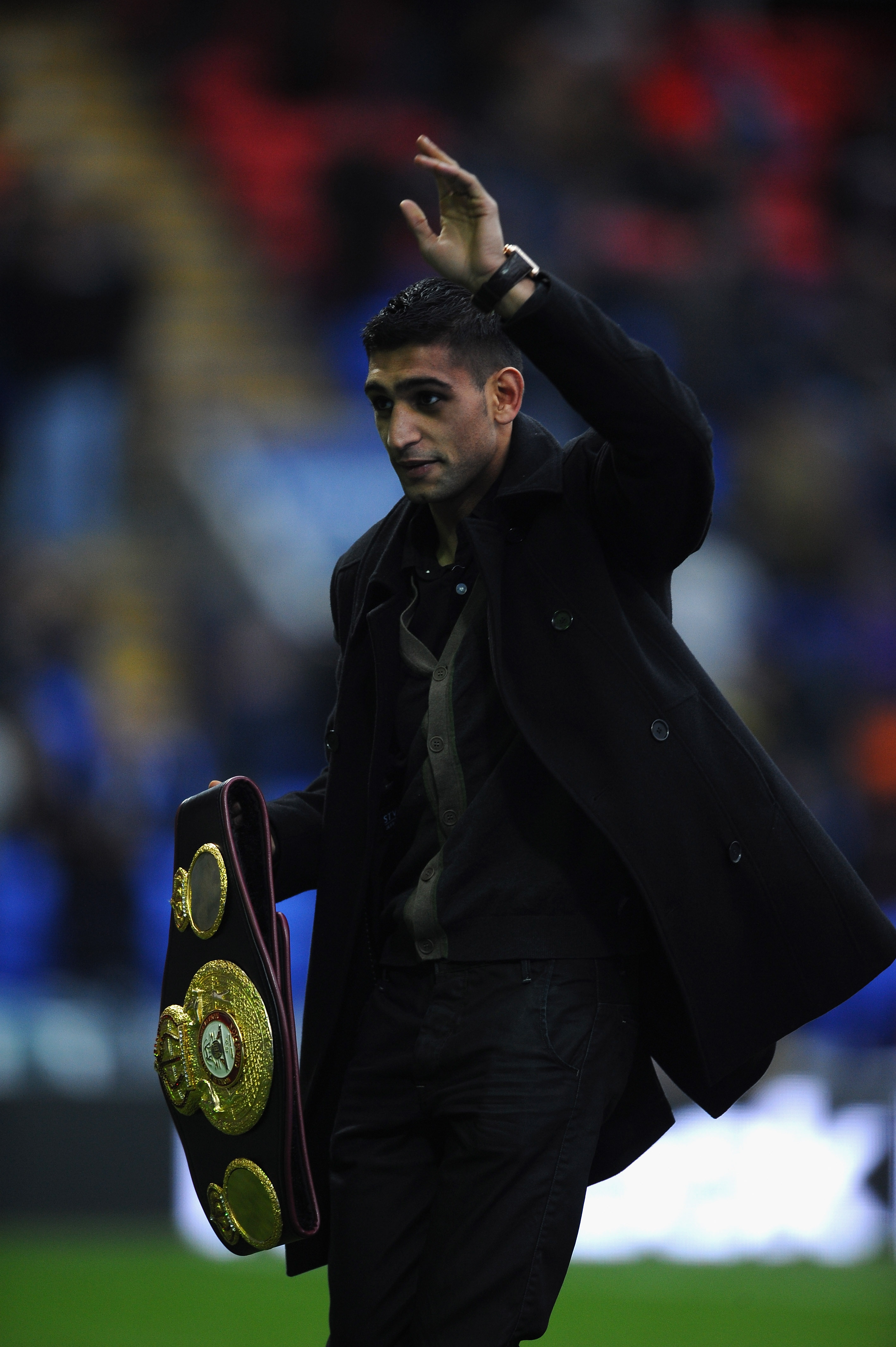 Amir Khan holding his world title as well as his piece of boxing's future in his hands.