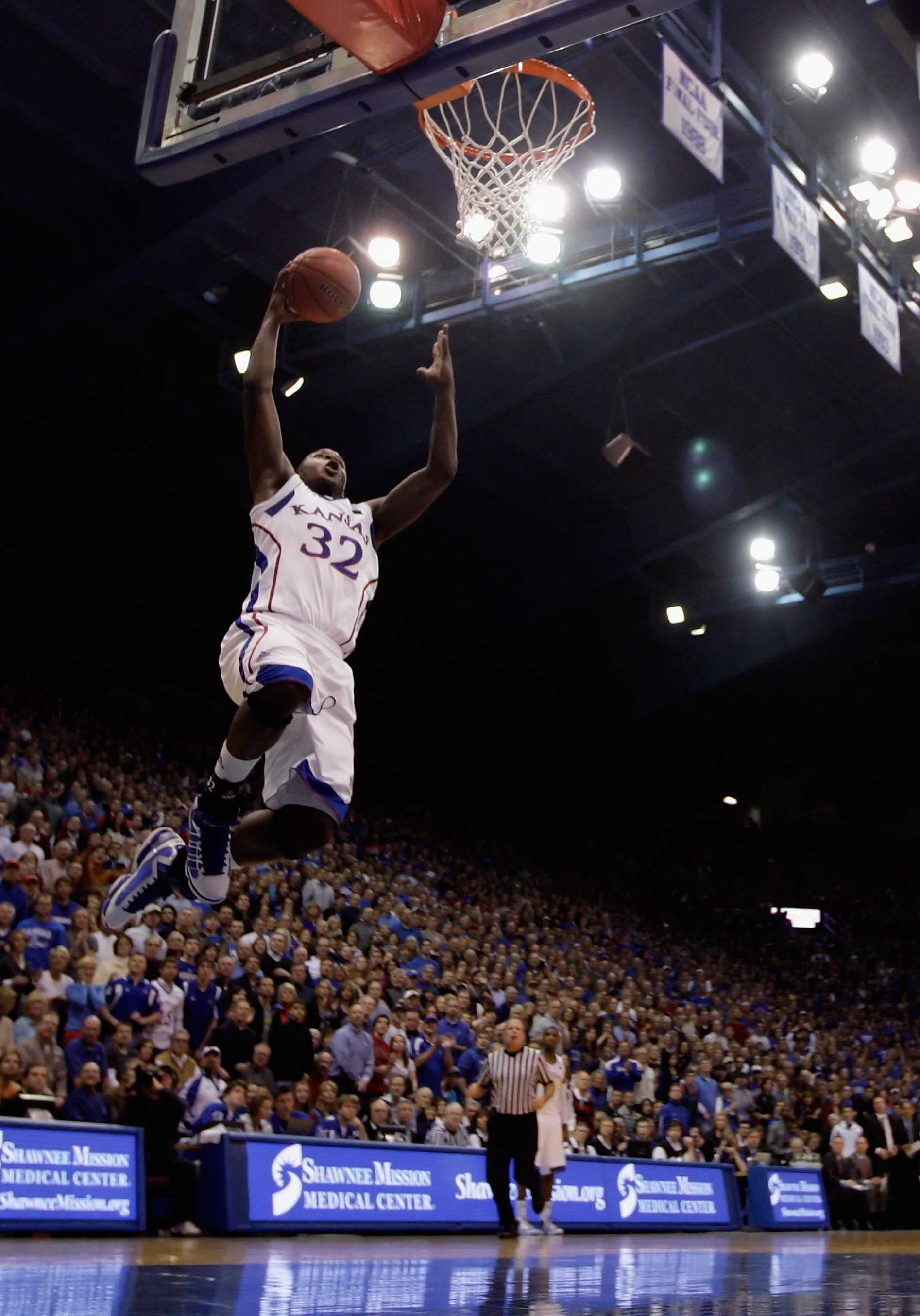 LAWRENCE, KS - JANUARY 22:  Josh Selby #32 of the Kansas Jayhawks dunks during the game against the Texas Longhorns on January 22, 2011 at Allen Fieldhouse in Lawrence, Kansas.  (Photo by Jamie Squire/Getty Images)