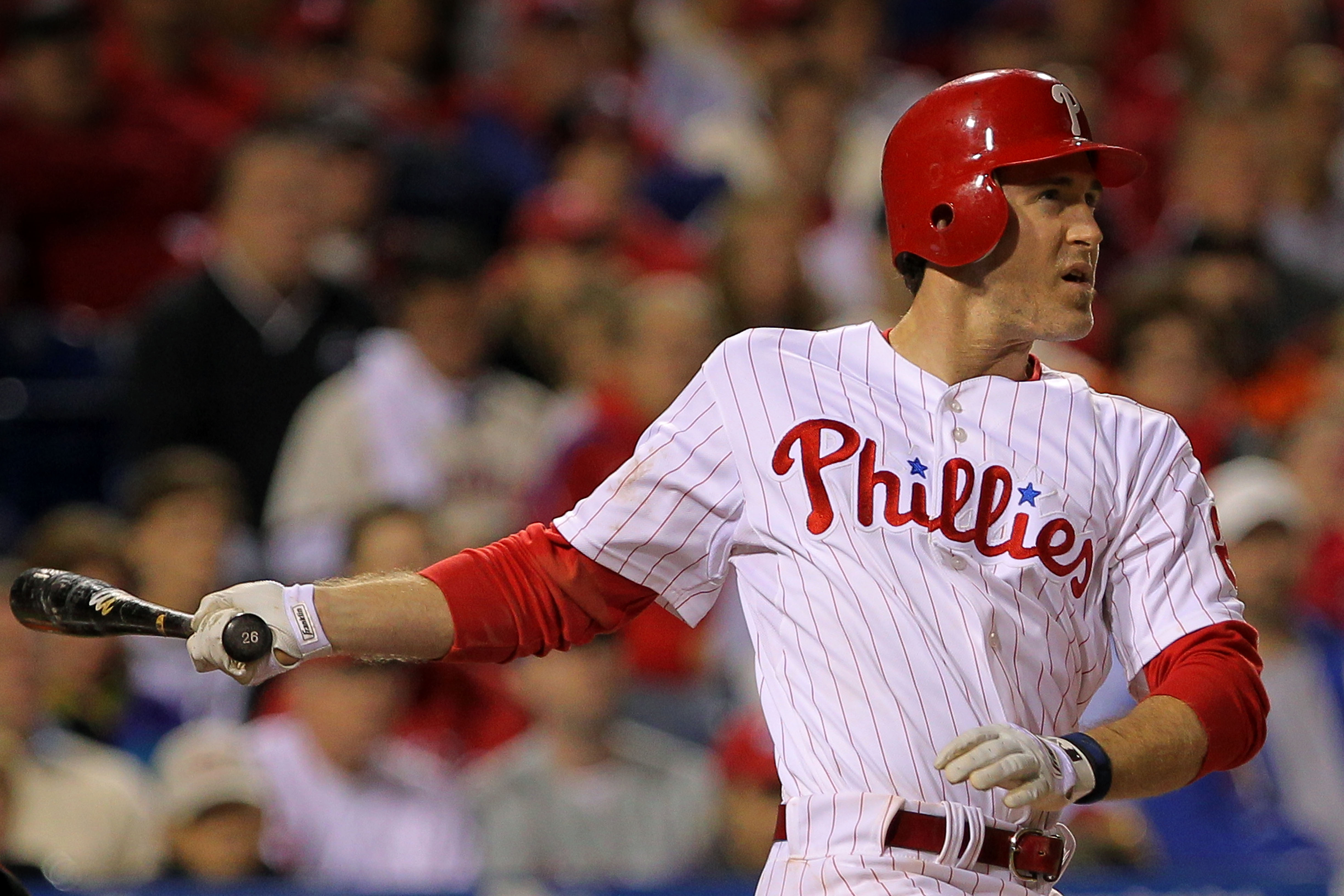 PHILADELPHIA - OCTOBER 17:  Chase Utley #26 of the Philadelphia Phillies connects for a long fly ball out to advance the runners against the San Francisco Giants in Game Two of the NLCS during the 2010 MLB Playoffs at Citizens Bank Park on October 17, 201