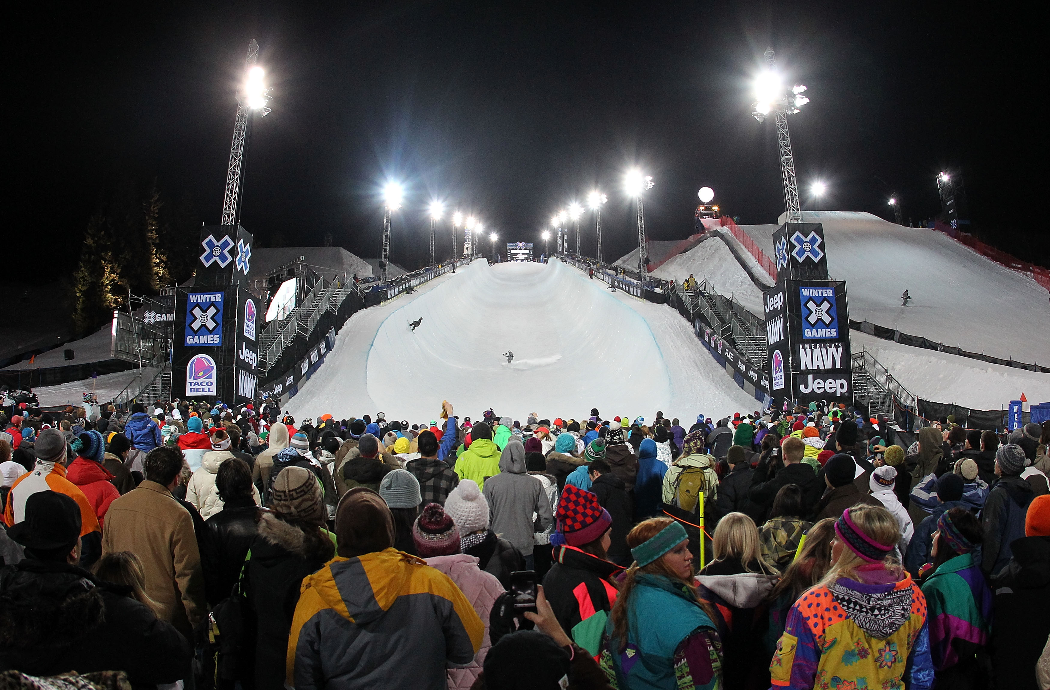 ASPEN, CO - JANUARY 28:  Spectators gather at the bottom of the halfpipe for Men's Snowboard Superpipe Eliminations at Winter X Games 14 at Buttermilk Mountain on January 28, 2010 in Aspen, Colorado.  (Photo by Doug Pensinger/Getty Images)
