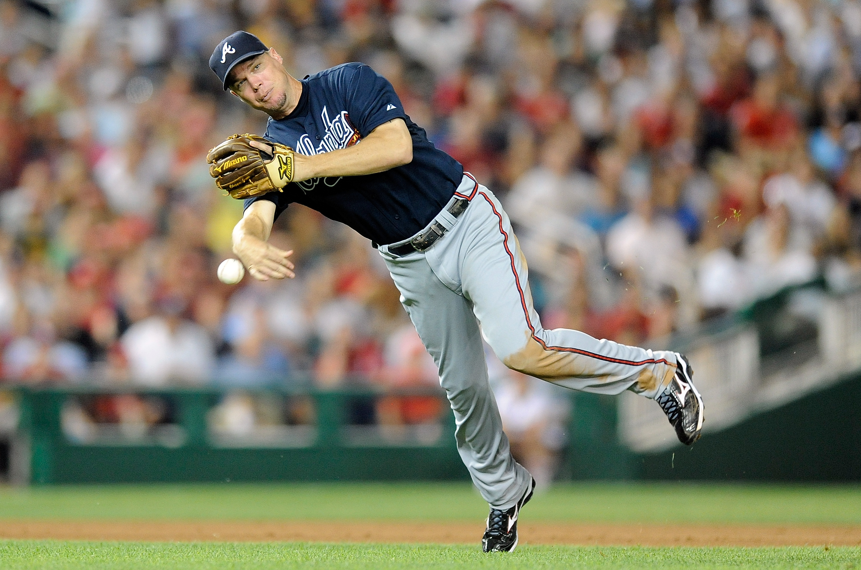 WASHINGTON - JULY 27:  Chipper Jones #10 of the Atlanta Braves throws the ball to first base against the Washington Nationals at Nationals Park on July 27, 2010 in Washington, DC.  (Photo by Greg Fiume/Getty Images)