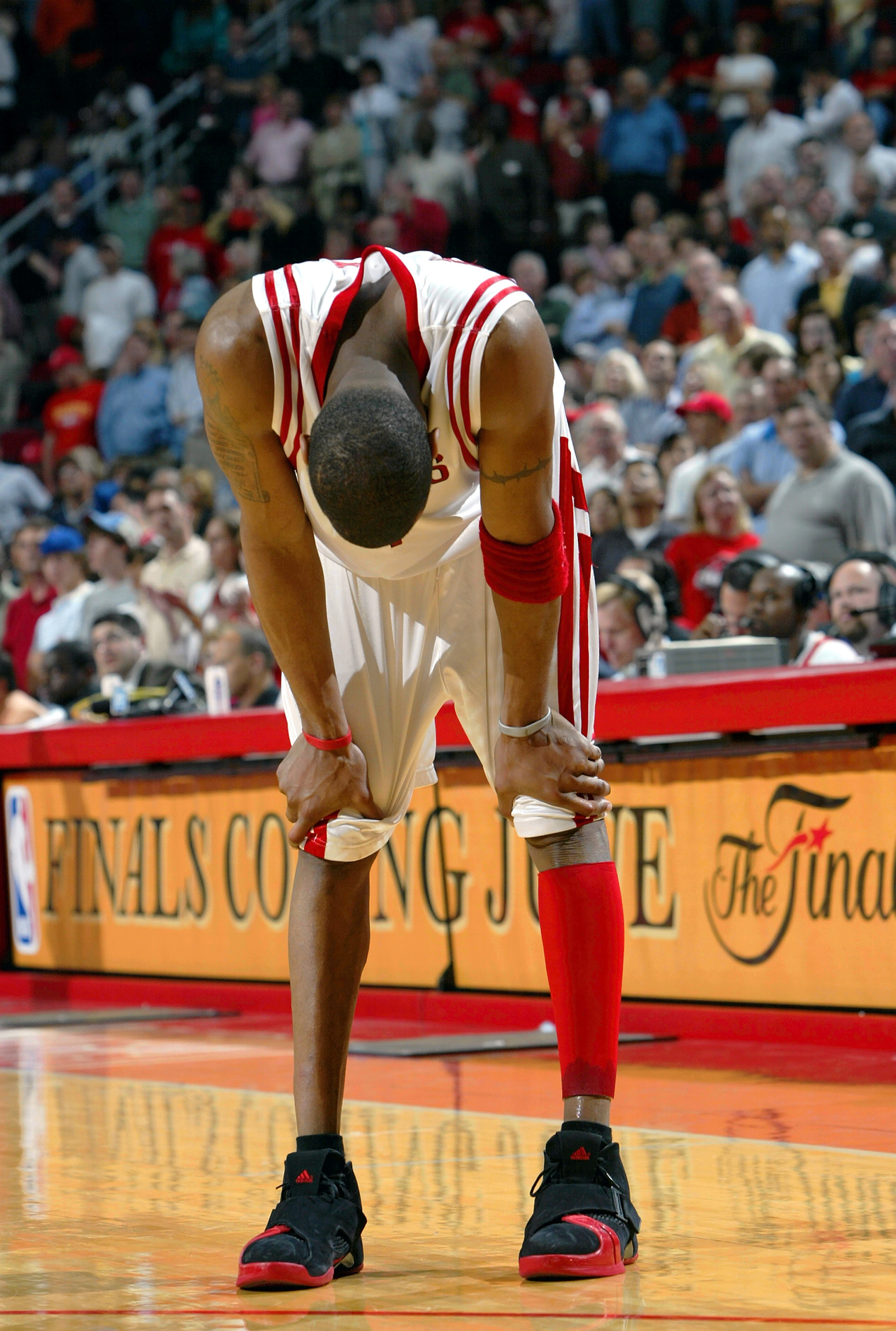 HOUSTON - APRIL 28:  Forward Tracy McGrady #1 of the Houston Rockets hangs his head in the final seconds of a 106-102 loss to the Dallas Mavericks in Game three of the Western Conference Quarterfinals during the 2005 NBA Playoffs on April 28, 2005 at the