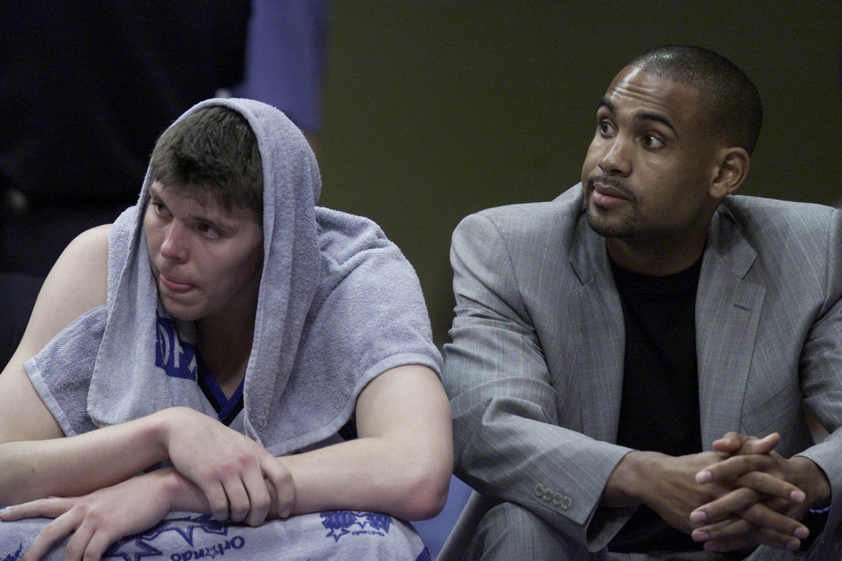 1 May 2001:  Mike Miller #50 and Grant Hill of the Orlando Magic watch from the bench during game four of round one in the NBA playoffs against the Orlando Magic at the TD Waterhouse in Orlando, Florida.  The Bucks won 112-104 to take the series 3-1.  DIG