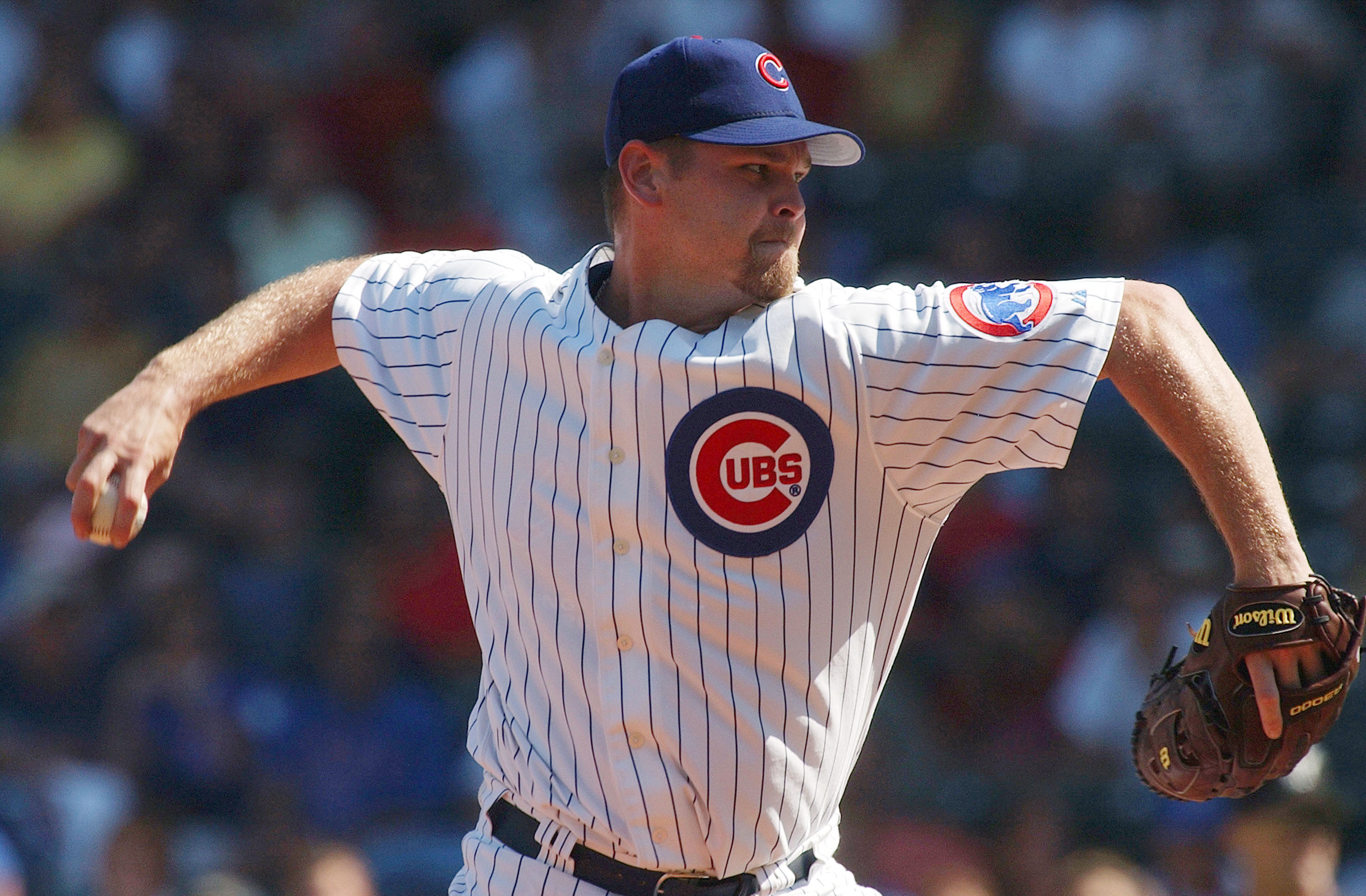 CHICAGO - SEPTEMBER 10: Kerry Wood #34 of the Chicago Cubs pitches against the Florida Marlins during game one of a doubleheader on September 10, 2004 at Wrigley Field in Chicago, Illinois. (Photo by Jonathan Daniel/Getty Images)