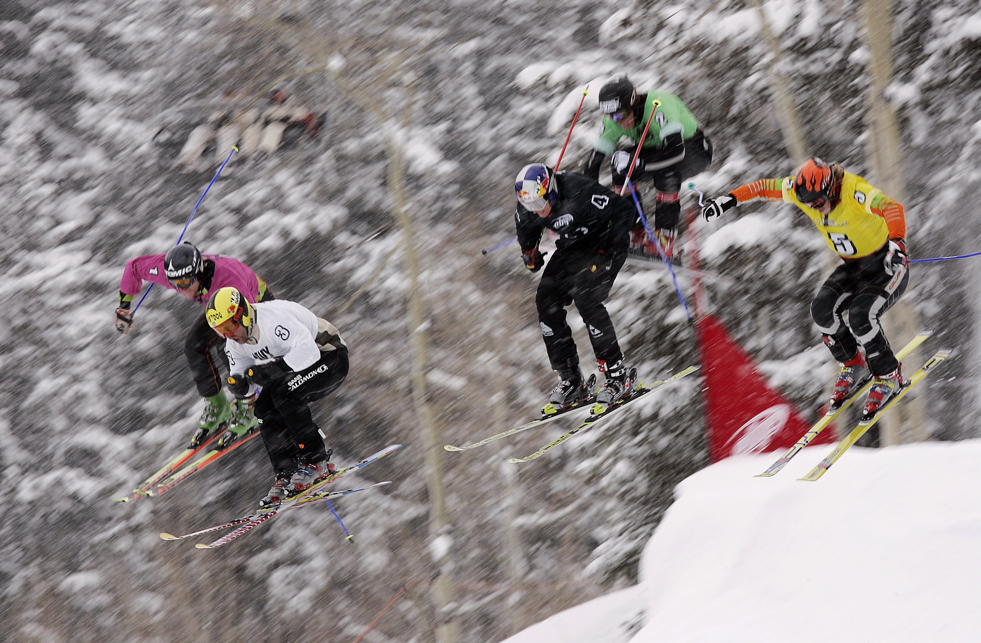 ASPEN, CO - JANUARY 29:  Lars Lewen, Reggie Crist, Chris Del Bosco, Tomas Kraus, Zach Crist and Casey Puckett take off a jump in the finals of Men's Skier X during Winter X Games 10 on January 29, 2006 at Buttermilk Mountain in Aspen, Colorado.  (Photo by