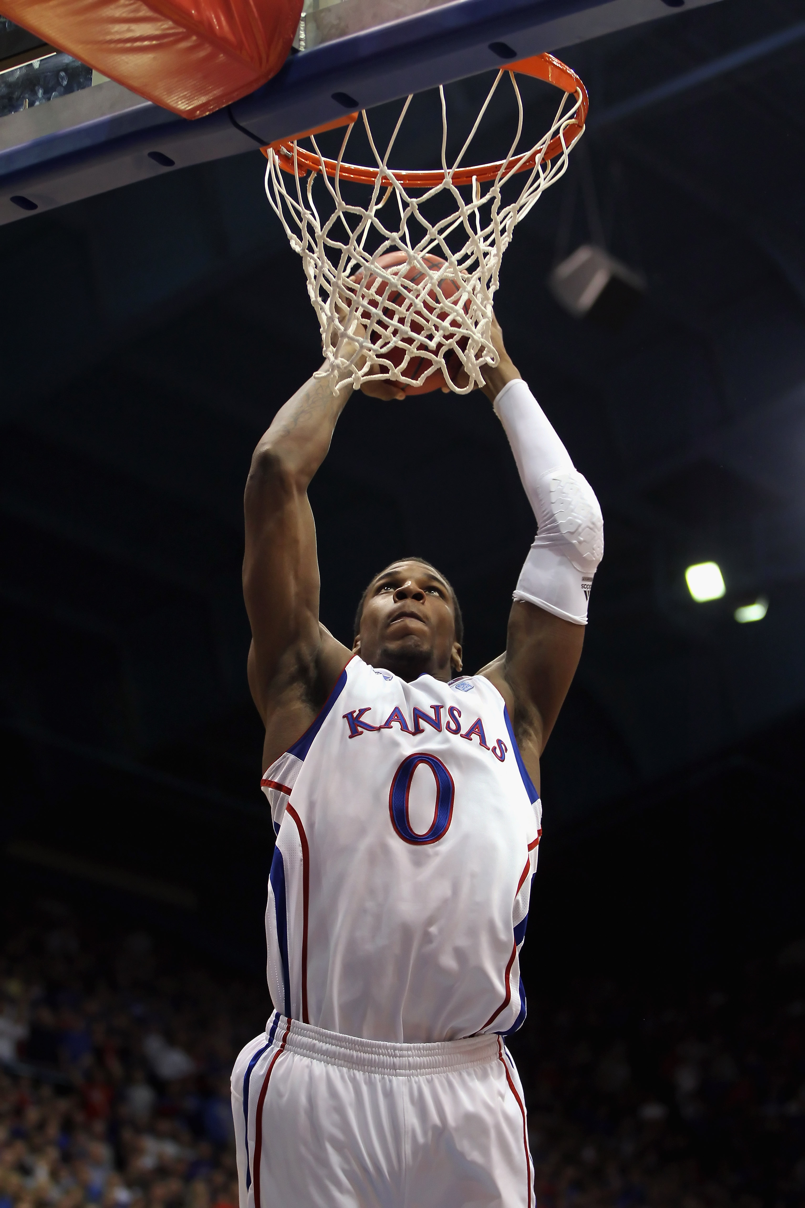 LAWRENCE, KS - DECEMBER 29:  Thomas Robinson #0 of the Kansas Jayhawks in action during the game against the University of Texas Arlington Mavericks on December 29, 2010 at Allen Fieldhouse in Lawrence, Kansas.  (Photo by Jamie Squire/Getty Images)