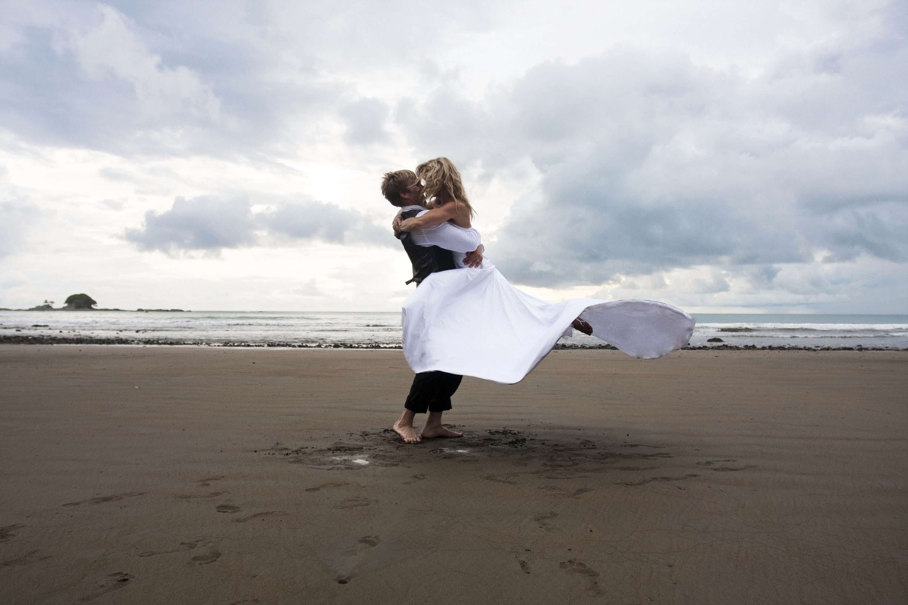 DOMINICAL, COSTA RICA - JUNE 19:  (R-L) In this handout provided by Gretchen Bleiler, Olympic snowboarder Gretchen Bleiler and Chris Hotell celebrate during their wedding on June 19, 2009 in Dominical, Costa Rica.  (Photo by Handout/Getty Images)