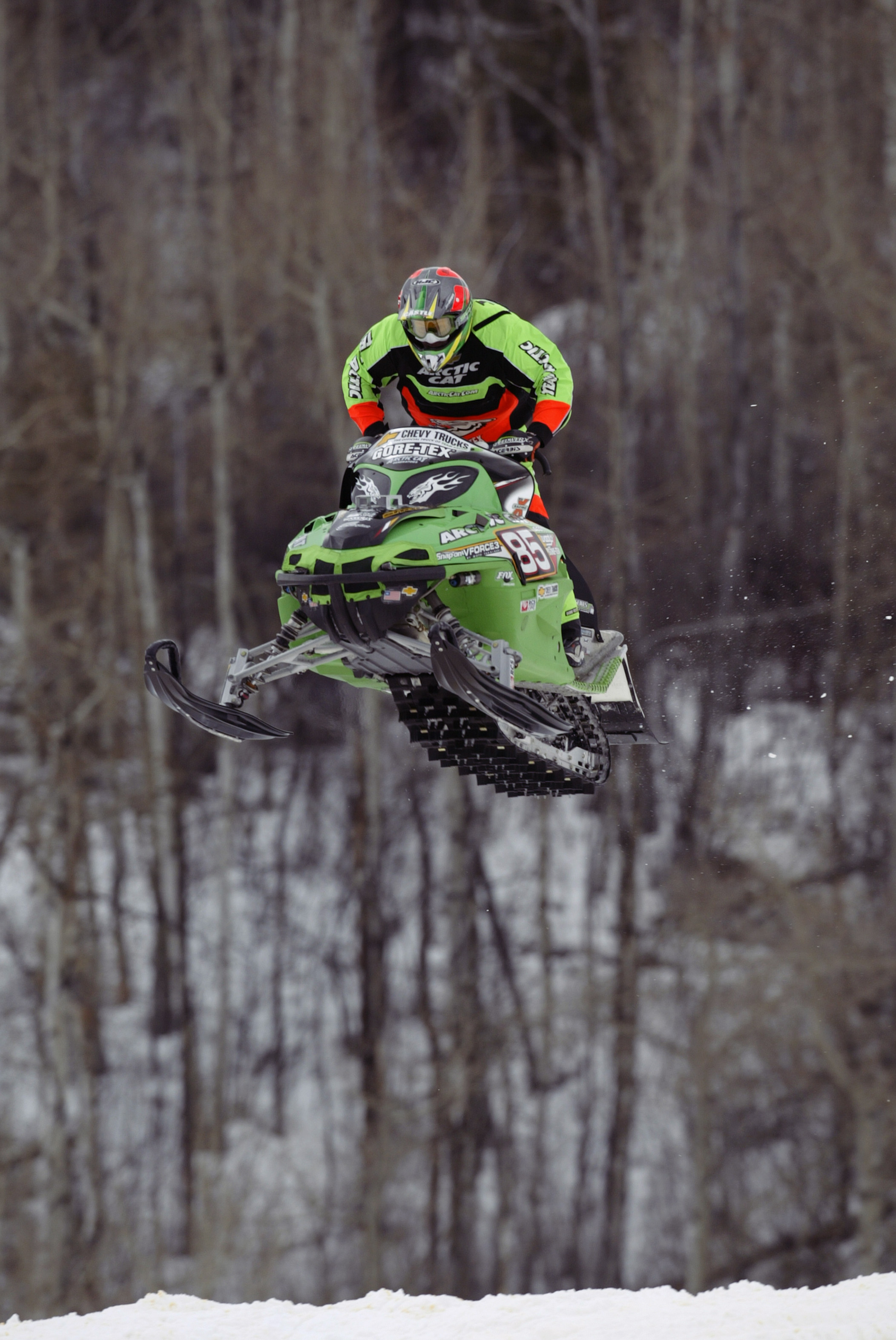 ASPEN, CO - JANUARY 30:  Tucker Hibbert of the USA flies through the air during the Snowmobile SnoCross competition of the Winter X Games VII at Buttermilk Mountain on January 30, 2003, in Aspen, Colorado. (Photo by Brian Bahr/Getty Images)