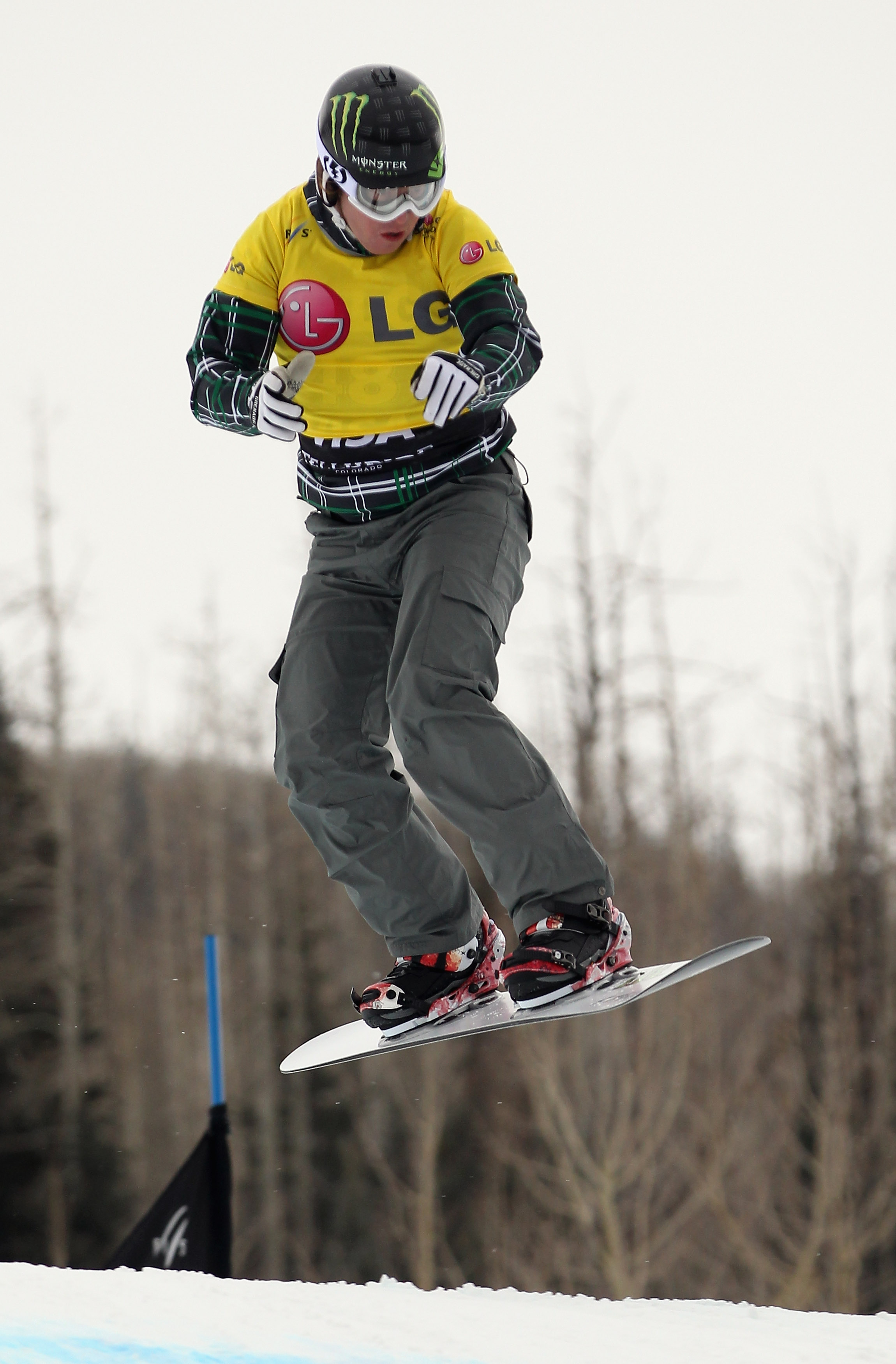 TELLURIDE, CO - DECEMBER 15:  Nate Holland of the USA descends the course as he finished fifth during Snowboard Cross Qualification at the LG Snowboard FIS World Cup on December 15, 2010 in Telluride, Colorado. Holland is currently holding the points lead